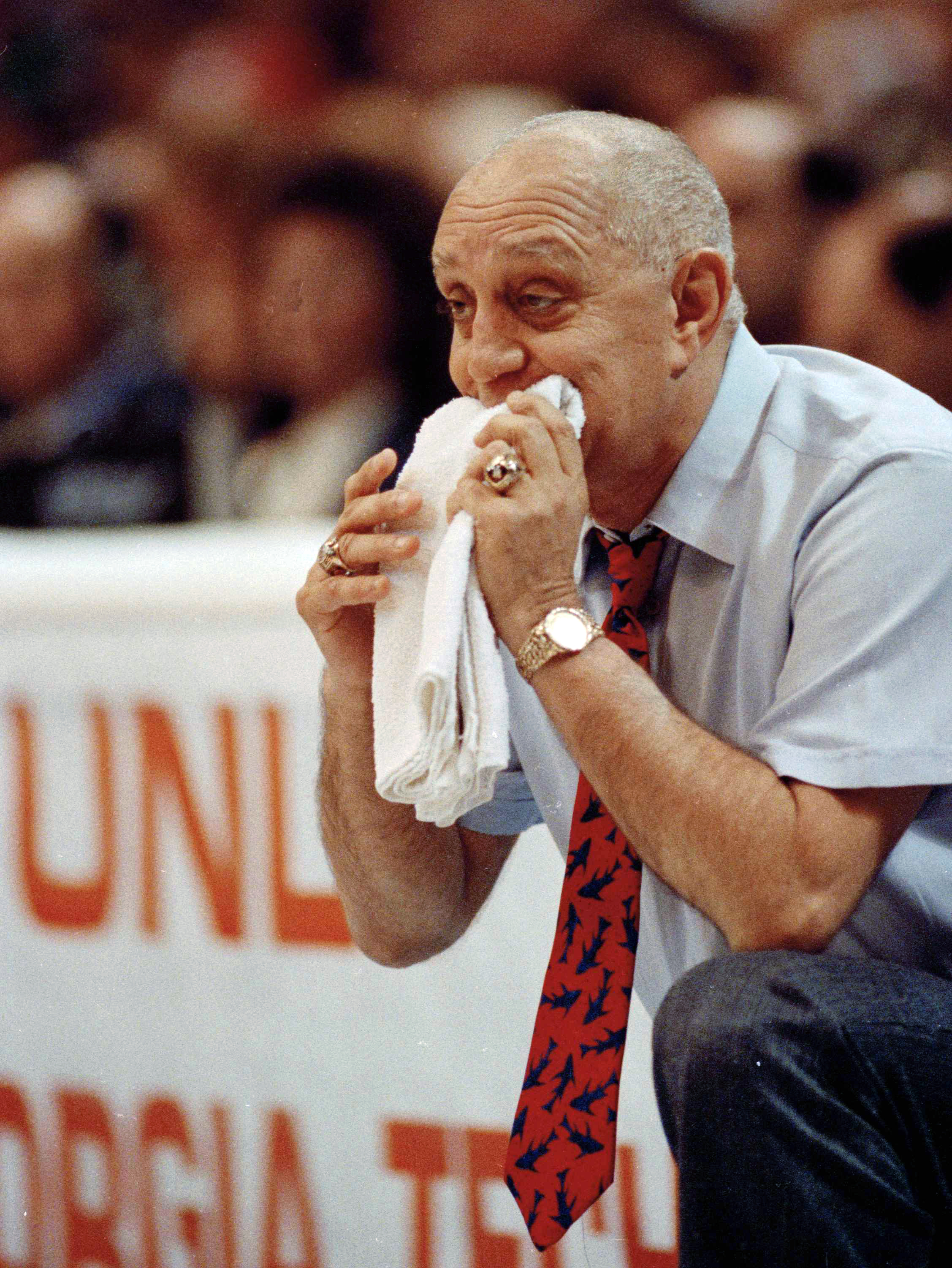 FILE - In this April 2, 1990, file photo, UNLV coach Jerry Tarkanian chews on his towel while watching his team play Duke in the championship game of the NCAA college basketball Final Four in Denver. The Hall of Fame coach who built a basketball dynasty a