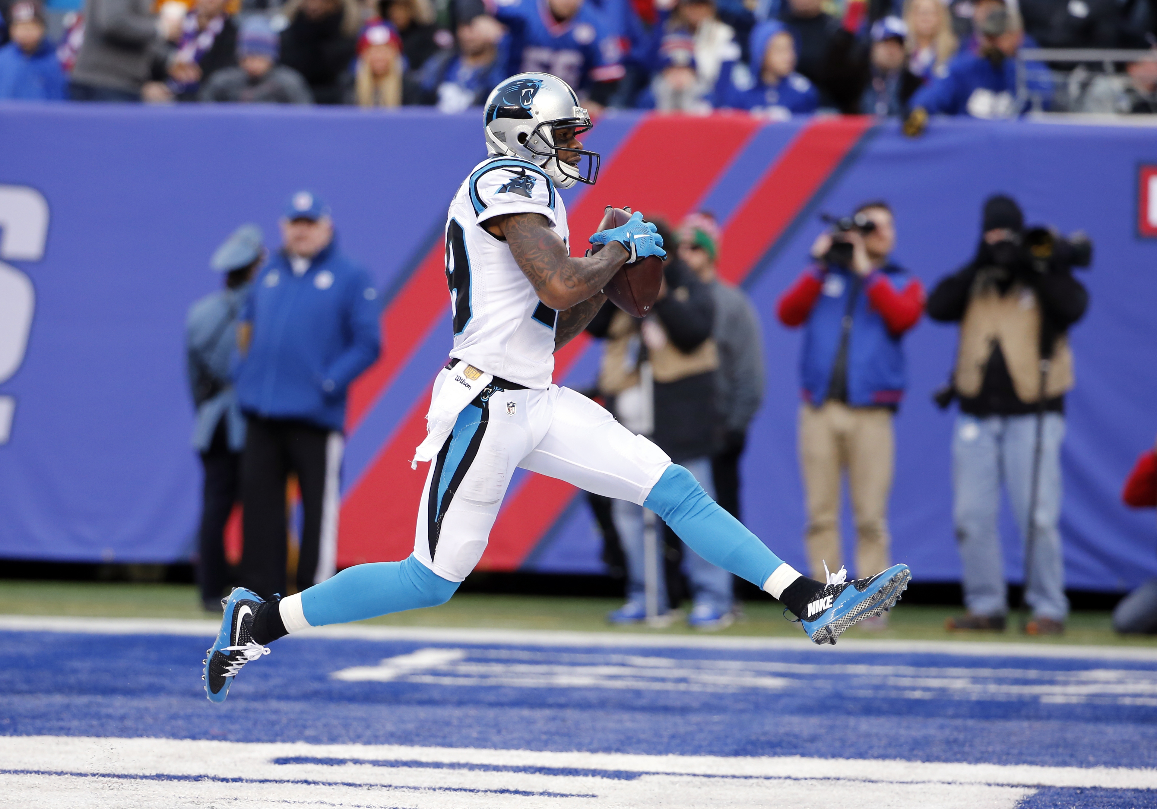 FILE - In this Sunday, Dec. 20, 2015, file photo, Carolina Panthers' Ted Ginn Jr. steps across the endzone after scoring a touchdown during the second half of an NFL football game against the New York Giants in East Rutherford, N.J. Ginn Jr. is making pla