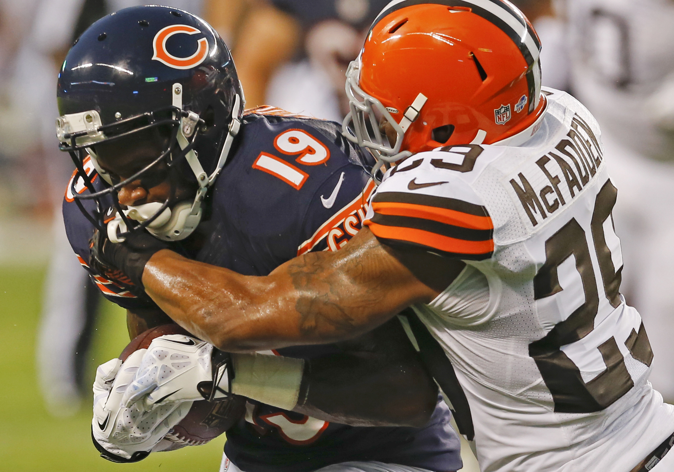 FILE- In this Aug. 29, 2013, file photo, Chicago Bears wide receiver Joe Anderson (19) is tackled by Cleveland Browns cornerback Leon McFadden (29) during the first half of a preseason NFL football game in Chicago. Anderson was signed to the New York Jets
