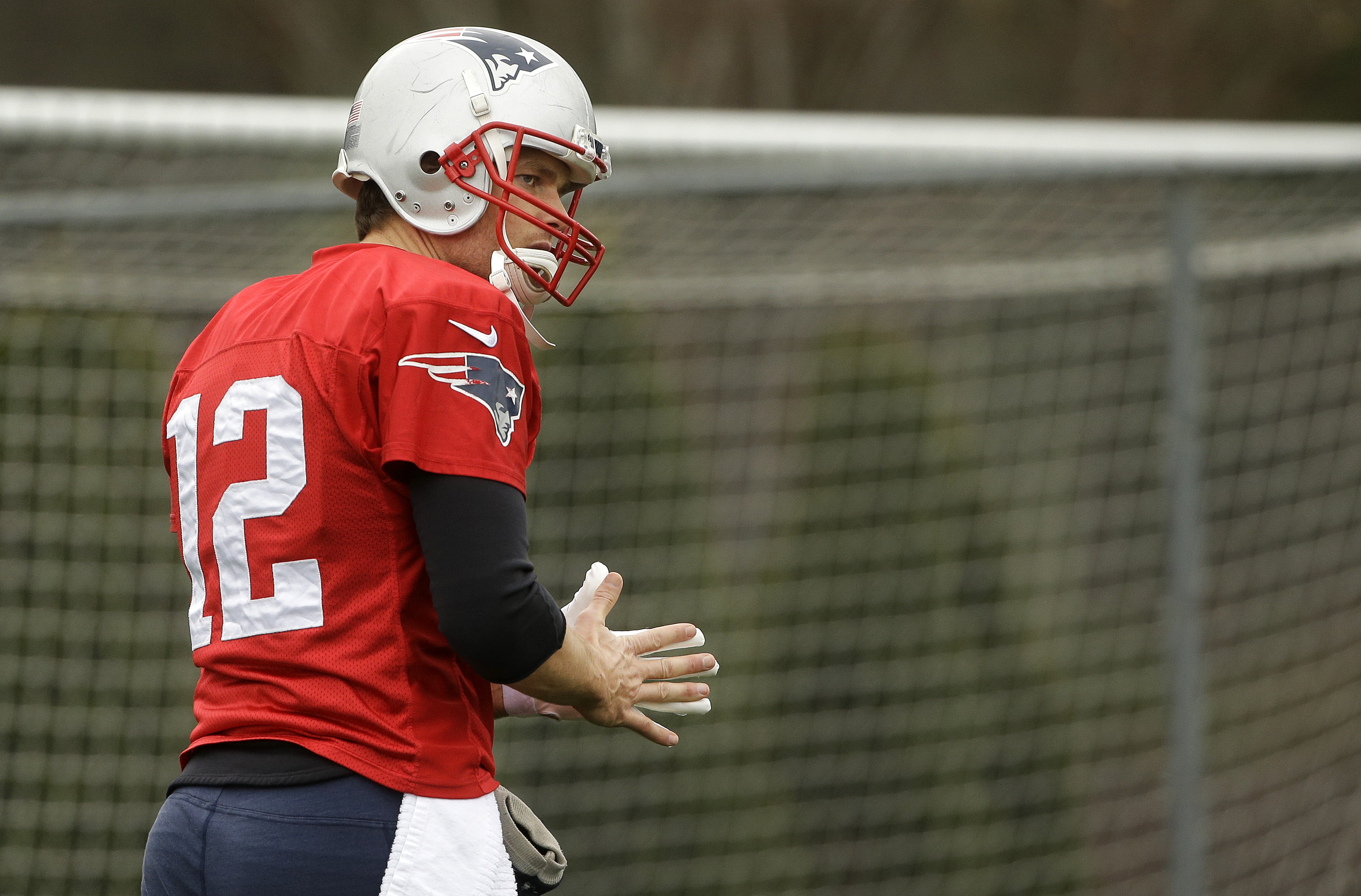 New England Patriots quarterback Tom Brady warms up during an NFL football practice, Wednesday, Dec. 23, 2015, in Foxborough, Mass. The Patriots are to play the New York Jets Sunday, Dec. 27, in East Rutherford, N.J. (AP Photo/Steven Senne)