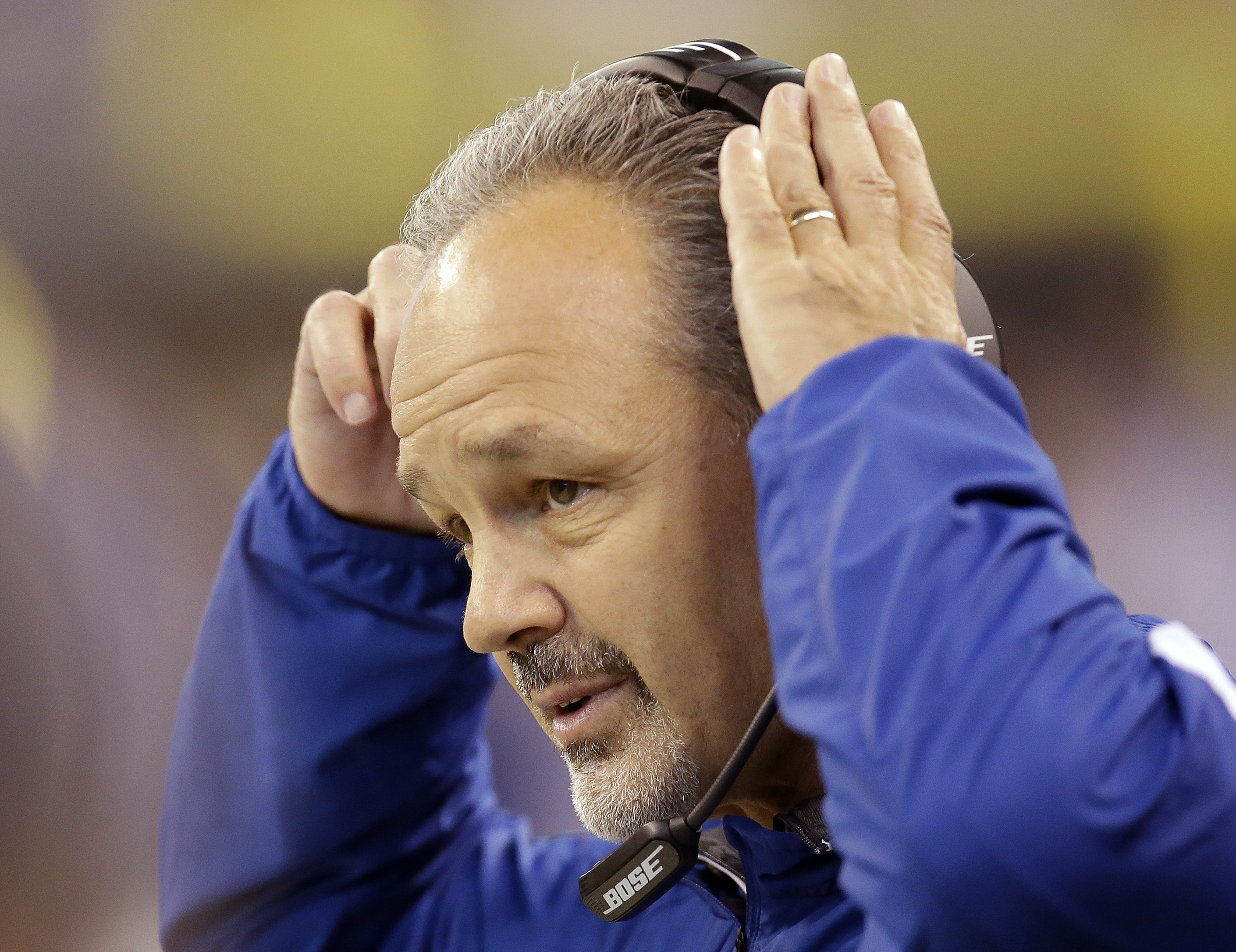 FILE -  This Dec. 20, 2015 file photo shows Indianapolis Colts head coach Chuck Pagano watching during the first half of an NFL football game against the Houston Texans in Indianapolis. The Colts will face the Miami Dolphins on Sunday, Dec. 27, 2015. (AP