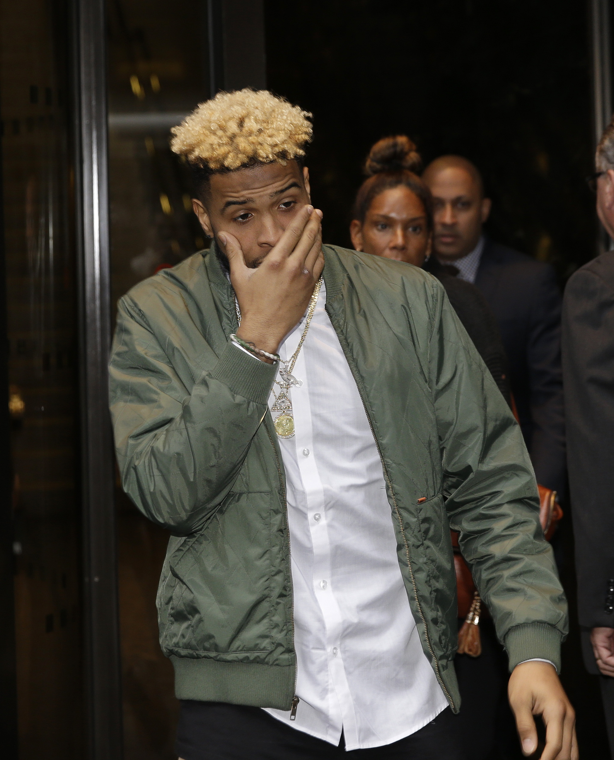 CORRECTS SPELLING TO BECKHAM NOT BECHKAM AND THAT THE NFL HAS NOT OVERTURNED THE ONE-GAME SUSPENSION New York Giants' Odell Beckham Jr. leaves NFL headquarters in New York, Wednesday, Dec. 23, 2015. The NFL is expected to rule on the appeal of Beckham's o