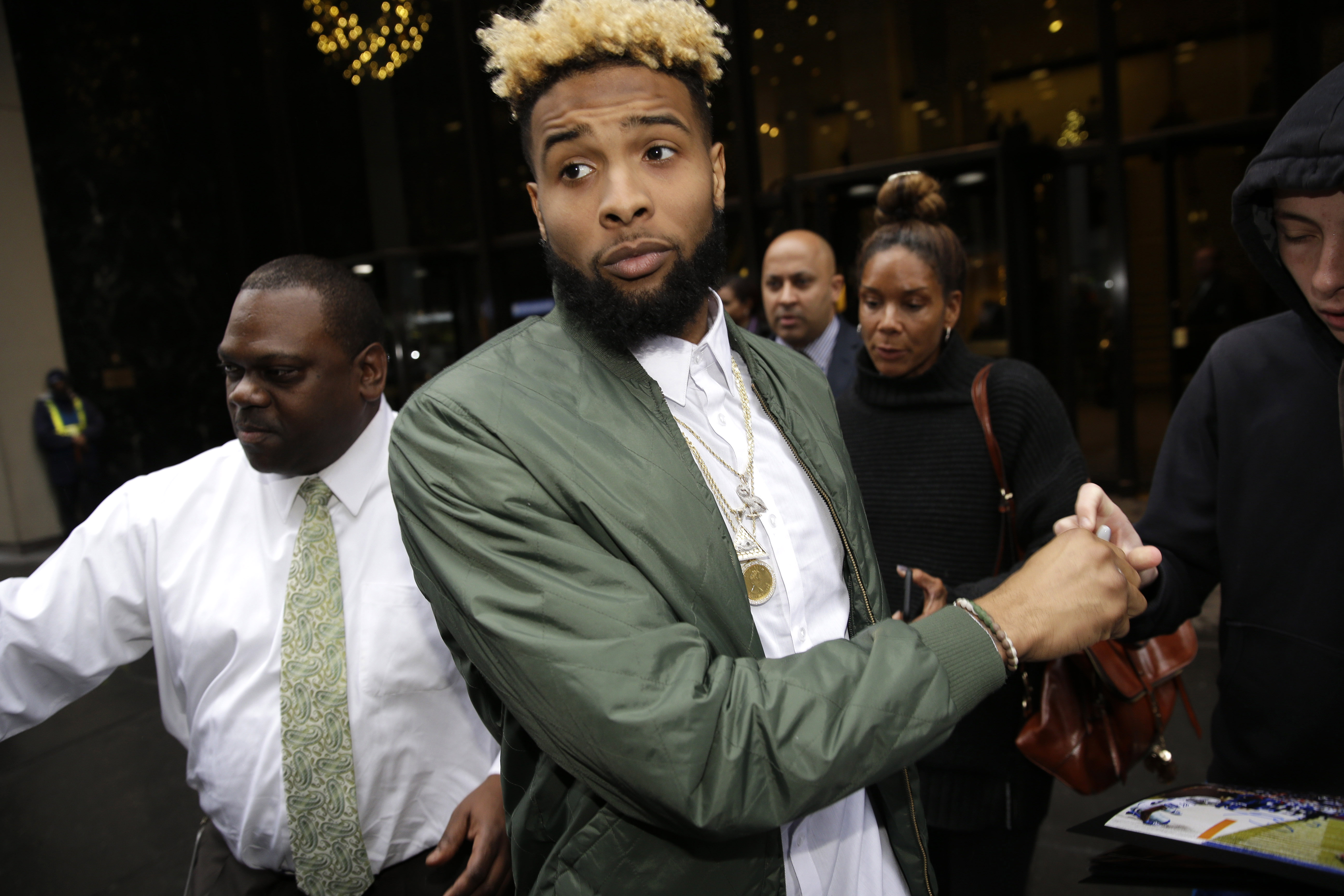 New York Giants' Odell Beckham Jr. leaves NFL headquarters in New York, Wednesday, Dec. 23, 2015. Hearing officer James Thrash upheld the suspension for multiple violations of safety-related playing rules after hearing an appeal by the New York Giants wid