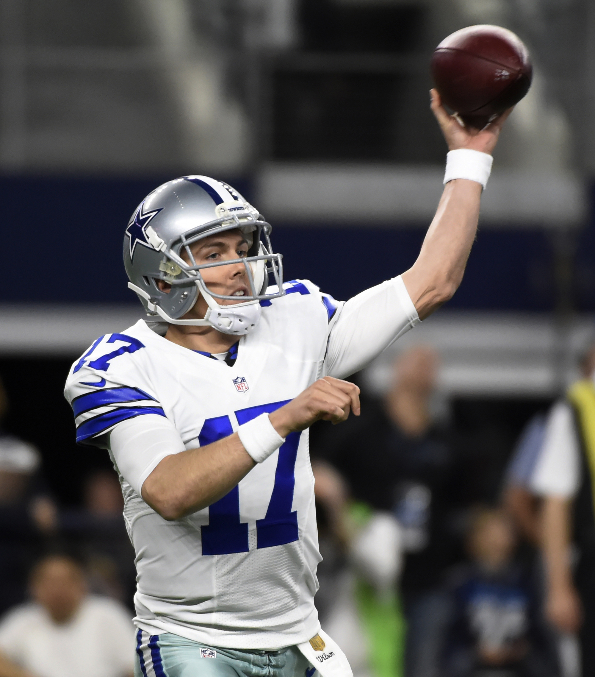 FILE - In this Dec. 19, 2015, file photo, Dallas Cowboys quarterback Kellen Moore (17) throws a pass during the first half of an NFL football game against the New York Jets in Arlington, Texas. Moore will be the fourth starting quarterback this season for