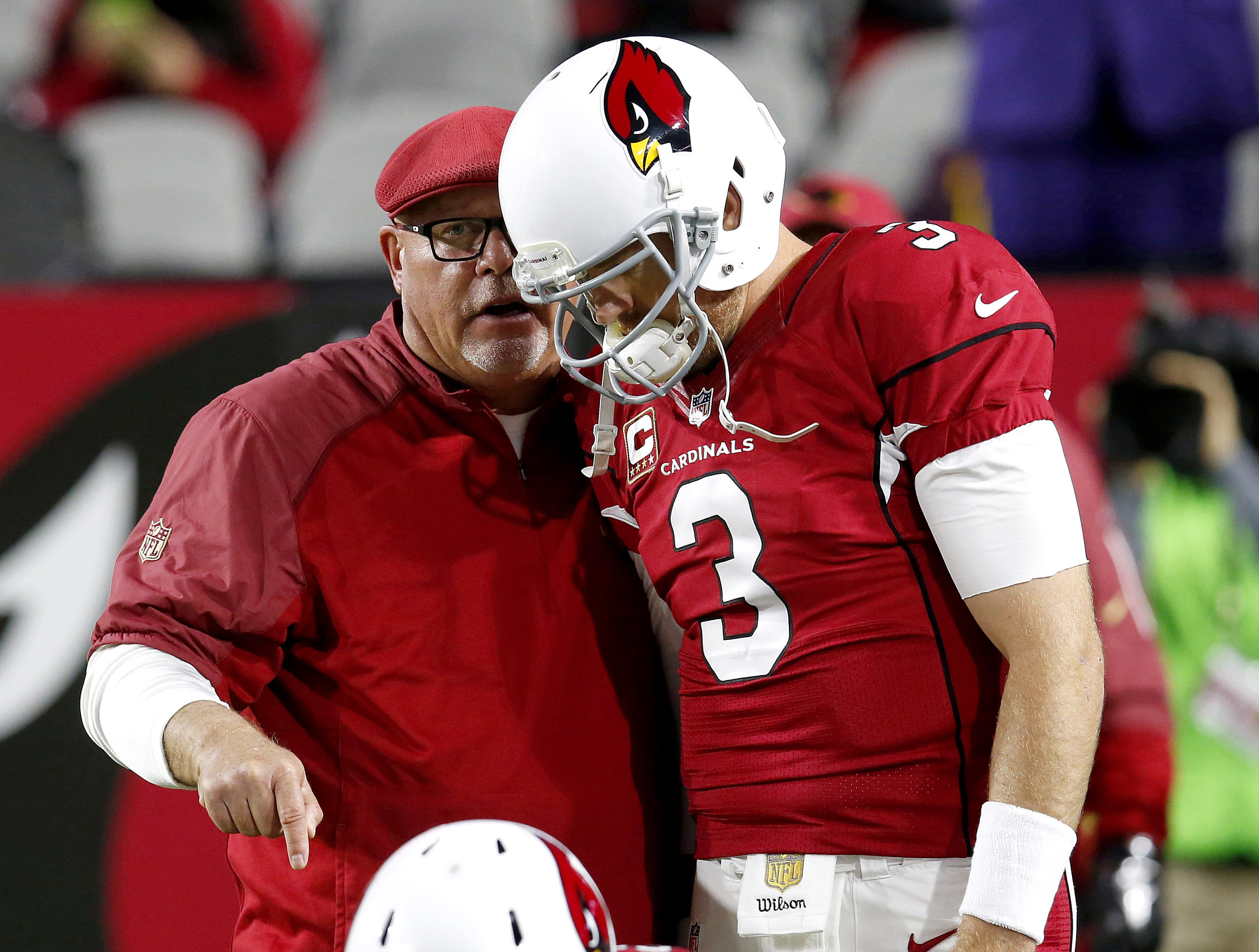 FILE - In this Dec. 10, 2015, file photo, Arizona Cardinals quarterback Carson Palmer and coach Bruce Arians talk prior to an NFL football game against the Minnesota Vikings in Glendale, Ariz. The unbeaten Carolina Panthers are understandably hogging the