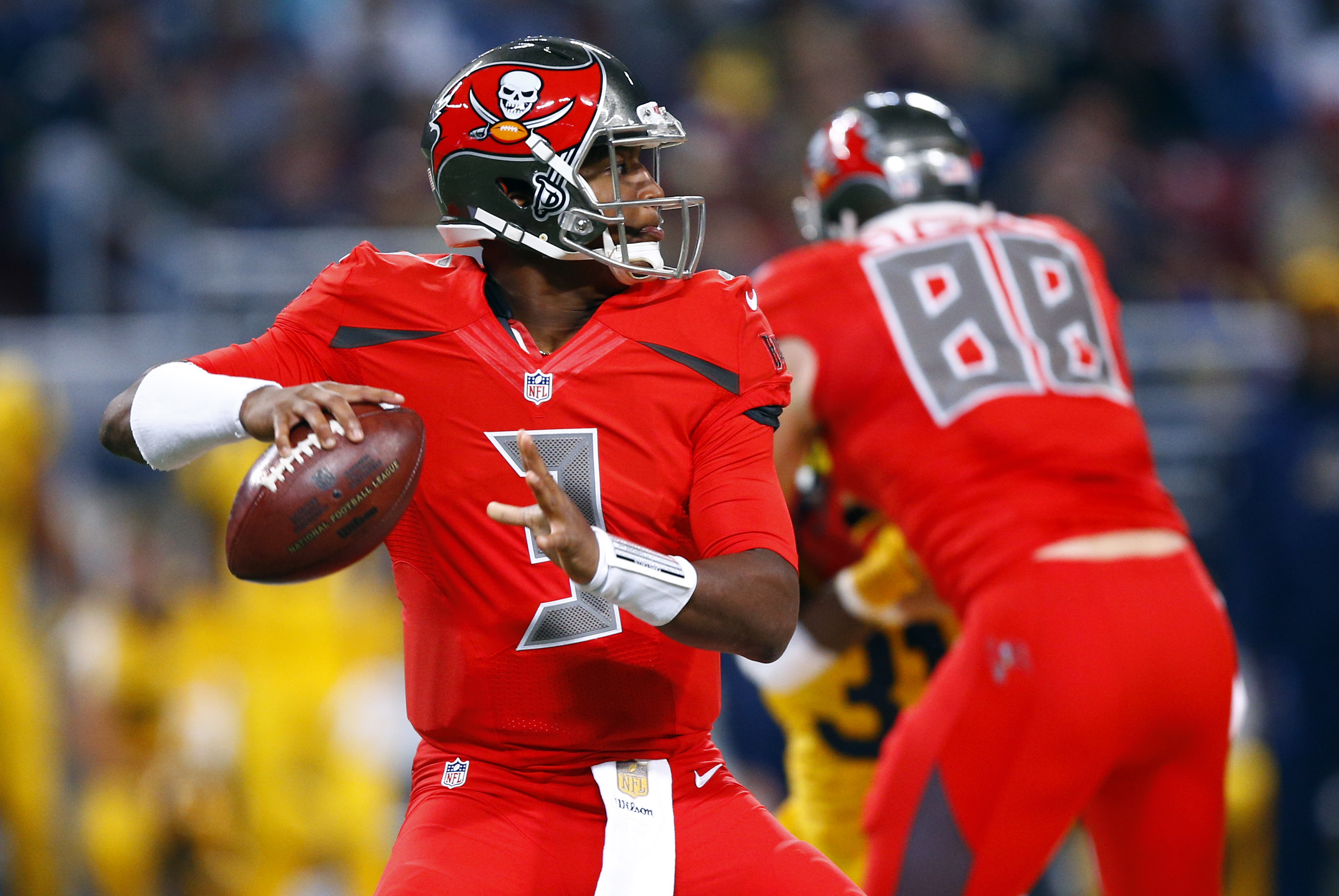 FILE - In this Dec. 17, 2015, file photo, Tampa Bay Buccaneers quarterback Jameis Winston looks to pass during the first quarter of an NFL football game against the St. Louis Rams in St. Louis. The Buccaneers play the Chicago Bears on Sunday, Dec. 27, in