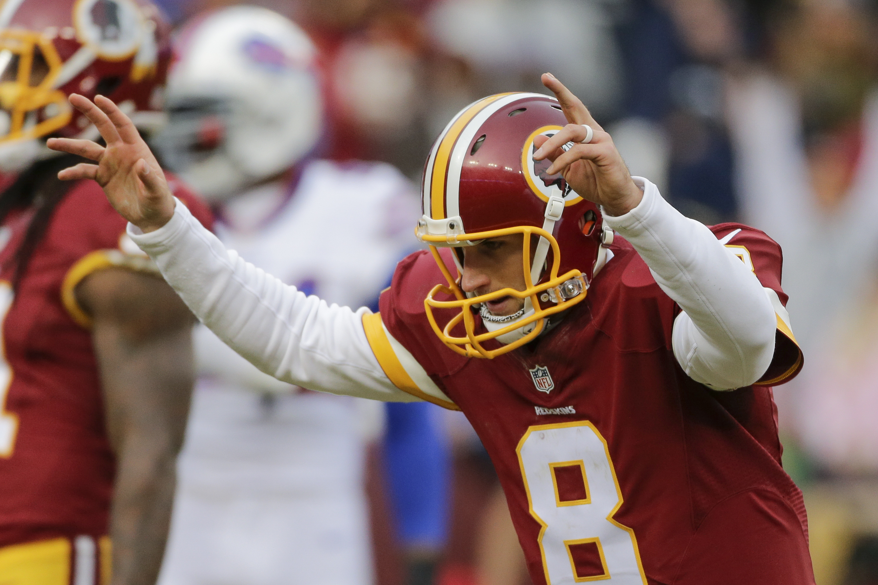 FILE - In this Dec. 20, 2015, file photo, Washington Redskins quarterback Kirk Cousins (8) celebrates wide receiver Pierre Garcon's touchdown during the second half of an NFL football game against the Buffalo Bills in Landover, Md. Redskins play the the P