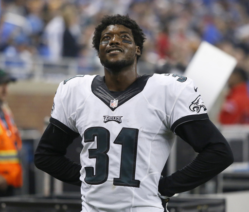 Philadelphia Eagles cornerback Byron Maxwell (31) watches a replay of Detroit Lions running back Joique Bell's touchdown during the second half of an NFL football game, Thursday, Nov. 26, 2015, in Detroit. The Lions defeated the Eagles 45-14. (AP Photo/Du