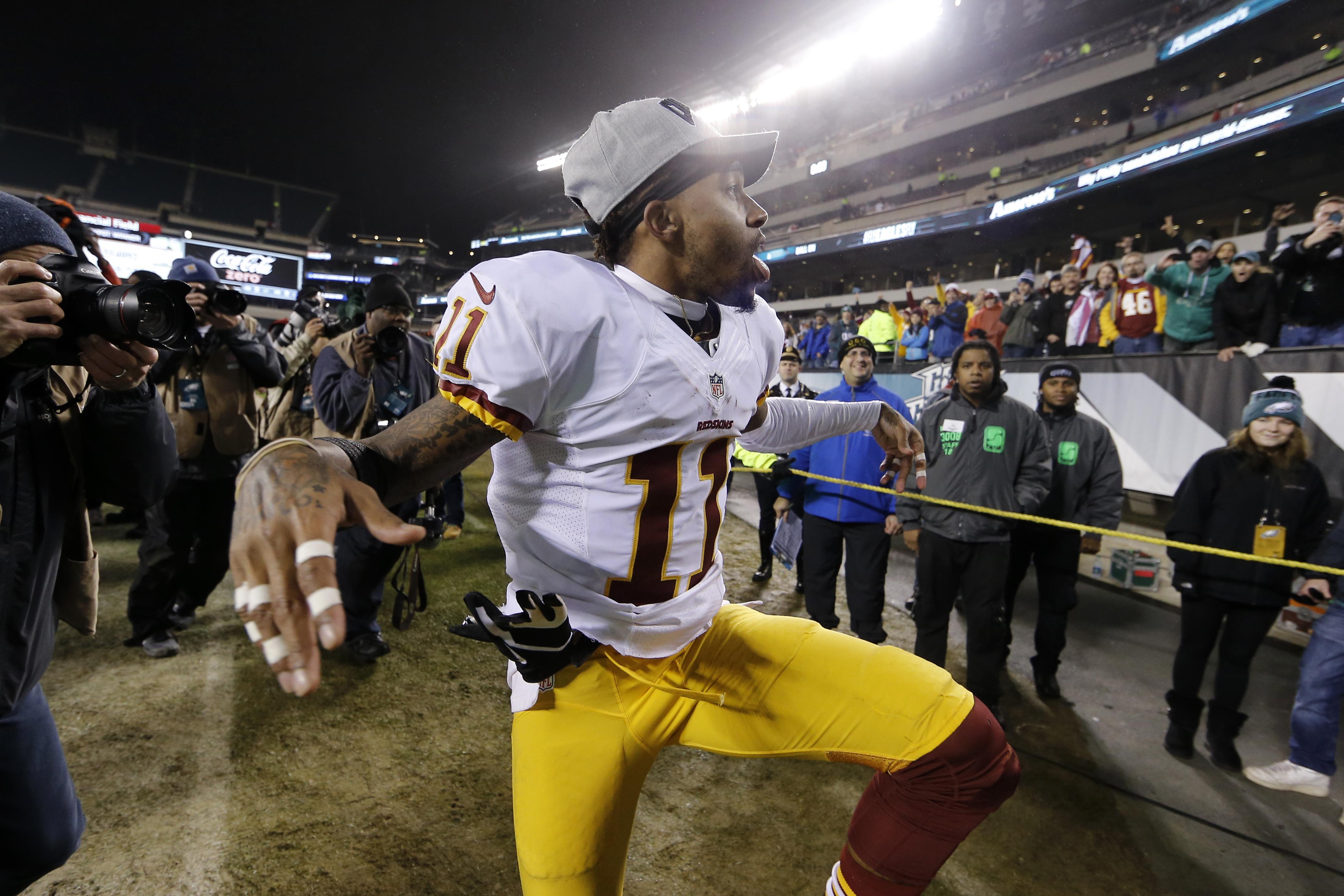 Washington Redskins' DeSean Jackson reacts as he walks off the field after an NFL football game against the Philadelphia Eagles, Saturday, Dec. 26, 2015, in Philadelphia. Washington won 38-24. (AP Photo/Matt Rourke)