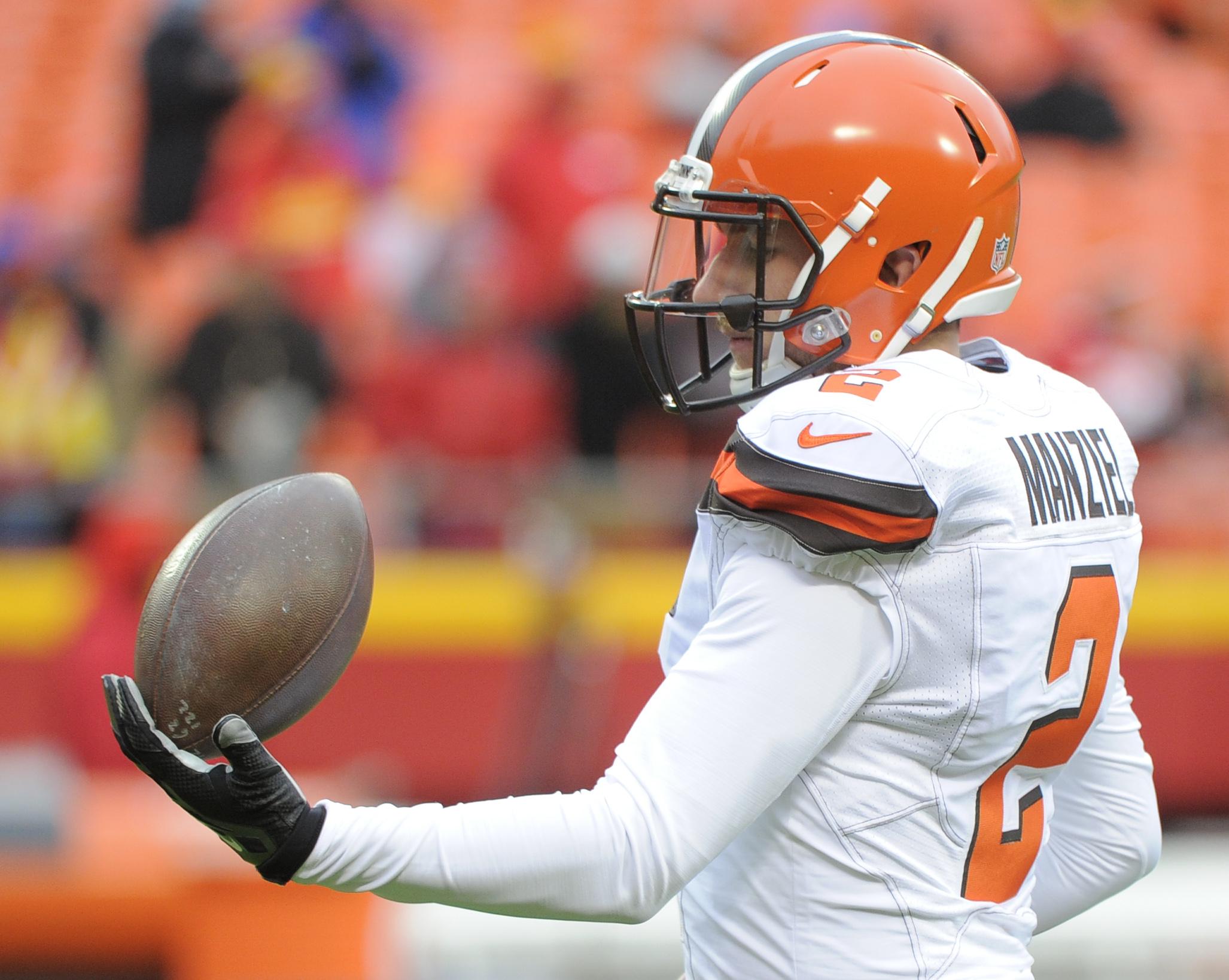 Cleveland Browns quarterback Johnny Manziel (2) balances a football before an NFL football game against the Kansas City Chiefs in Kansas City, Mo., Sunday, Dec. 27, 2015. (AP Photo/Ed Zurga)