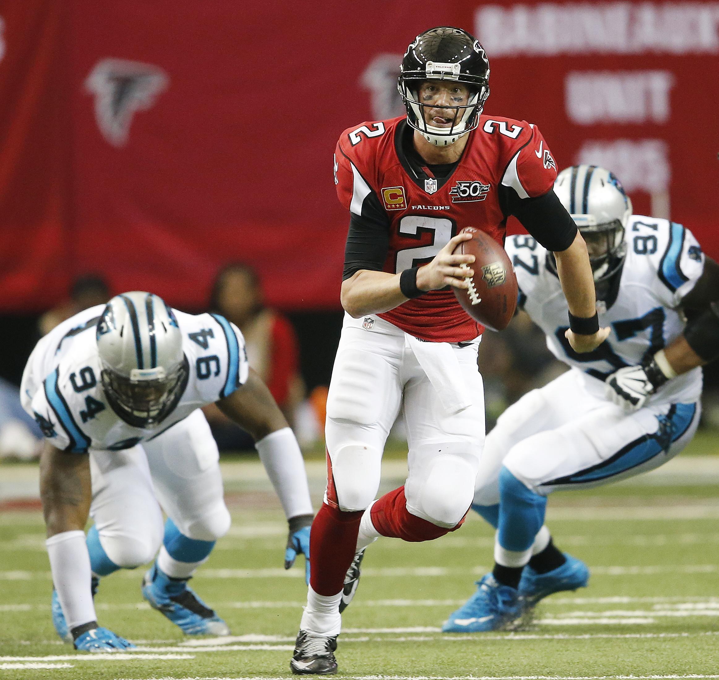 Atlanta Falcons quarterback Matt Ryan (2) runs out of the pocket against the Carolina Panthers during the second half of an NFL football game, Sunday, Dec. 27, 2015, in Atlanta. (AP Photo/John Bazemore)