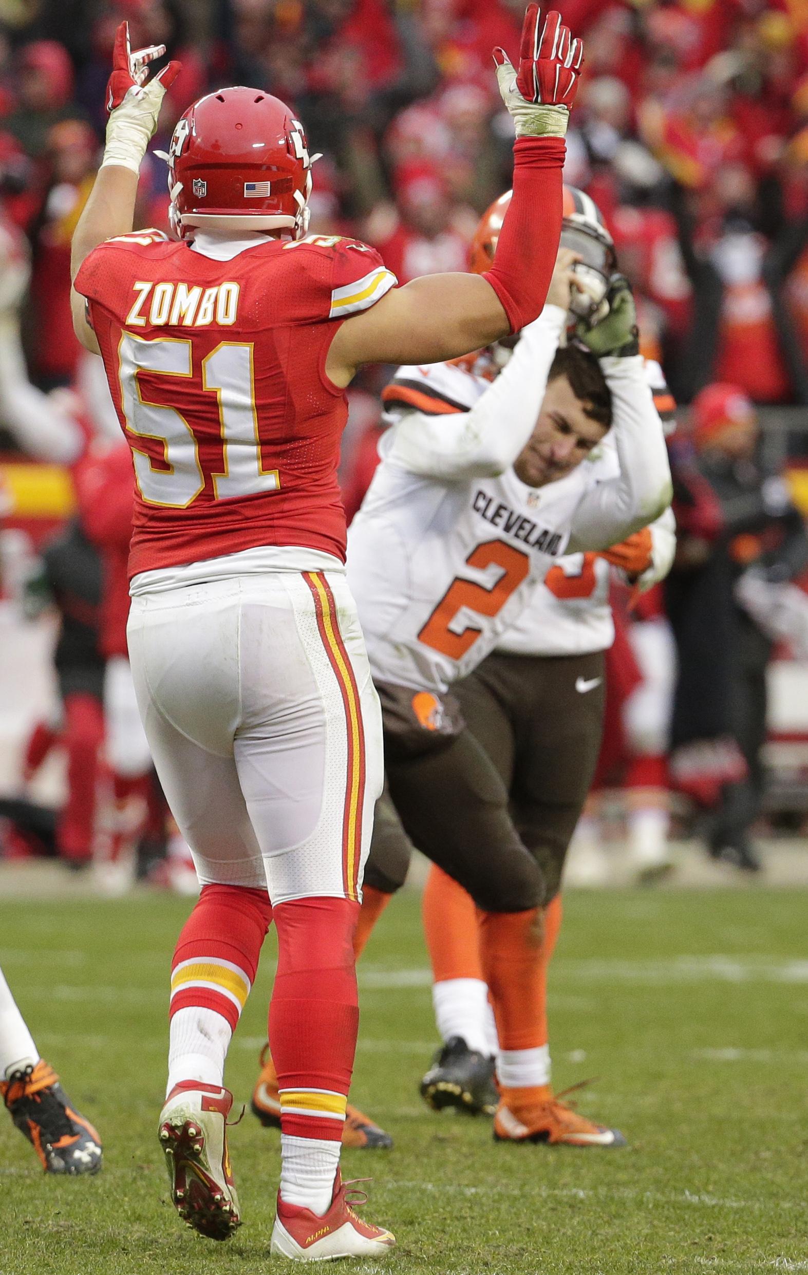 Cleveland Browns quarterback Johnny Manziel (2) slams his helmet as Kansas City Chiefs linebacker Frank Zombo (51) celebrates following an NFL football game in Kansas City, Mo., Sunday, Dec. 27, 2015. The Kansas City Chiefs won 17-13. (AP Photo/Charlie Ri