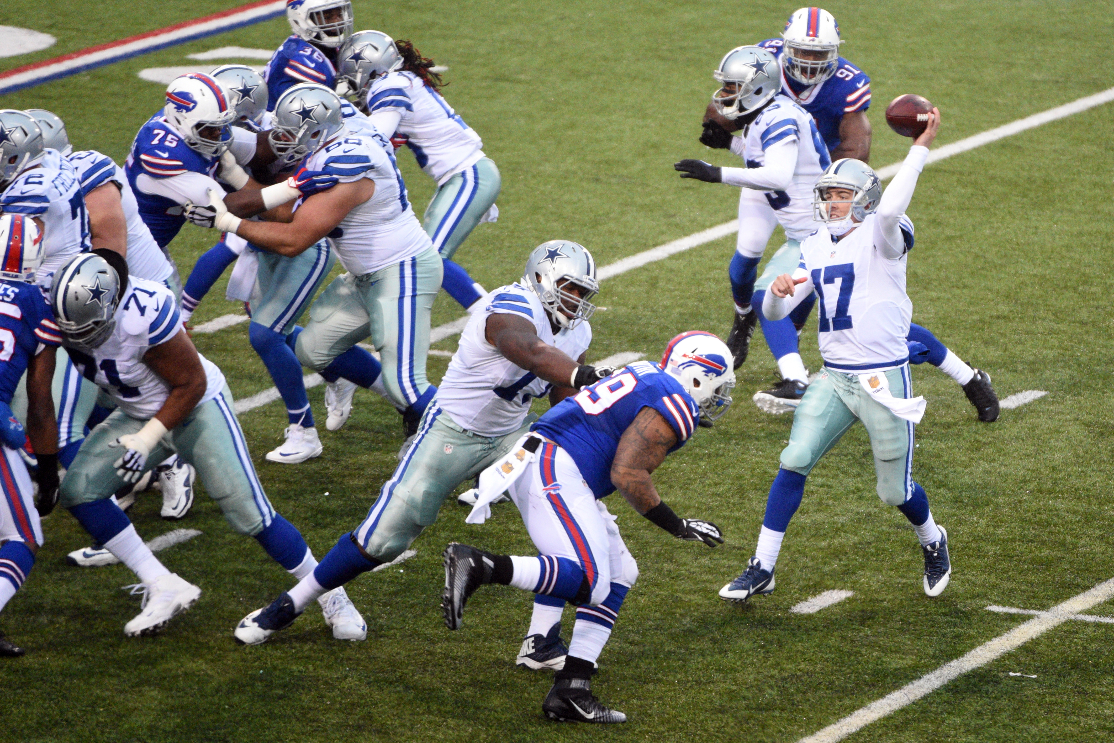 Dallas Cowboys quarterback Kellen Moore (17) throws a pass against the Buffalo Bills during the second half of an NFL football game, Sunday, Dec. 27, 2015, in Orchard Park, N.Y. (AP Photo/Gary Wiepert)