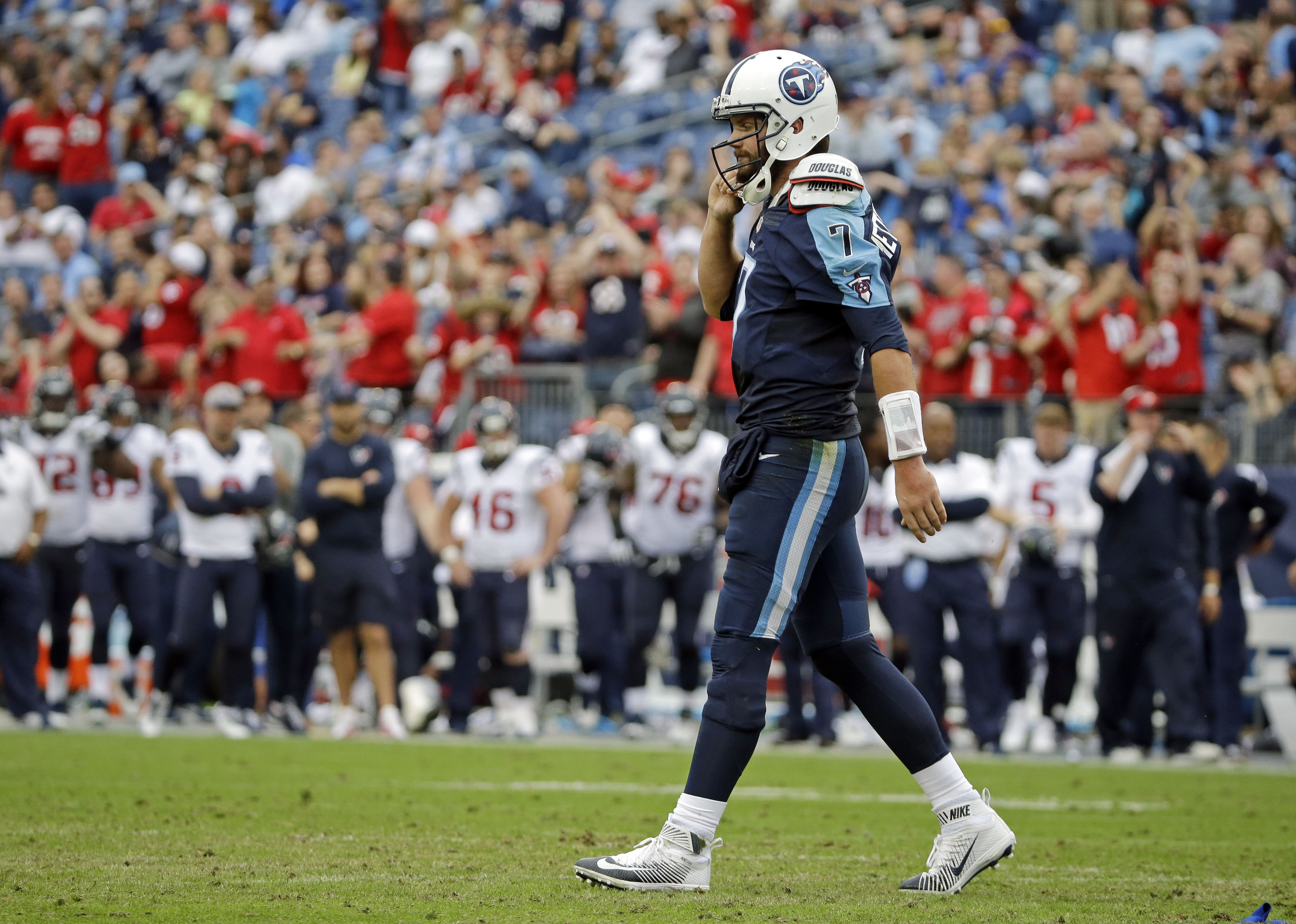 Tennessee Titans quarterback Zach Mettenberger walks to the sideline in the second half of a 34-6 loss to the Houston Texans in an NFL football game Sunday, Dec. 27, 2015, in Nashville, Tenn. (AP Photo/James Kenney)