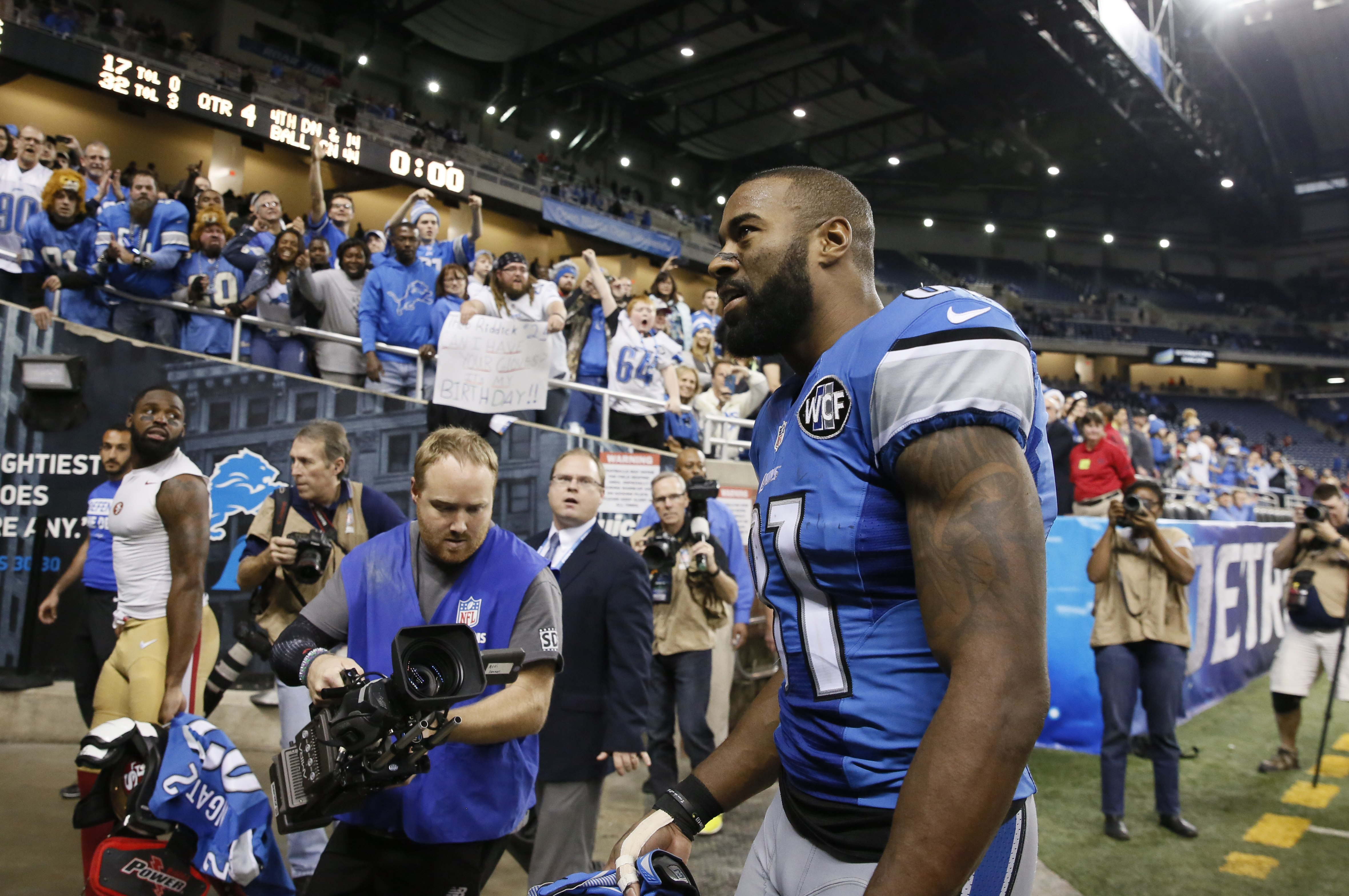 Detroit Lions wide receiver Calvin Johnson walks off the field after an NFL football game against the San Francisco 49ers, Sunday, Dec. 27, 2015, in Detroit. The Lions defeated the 49ers 32-17. (AP Photo/Rick Osentoski)