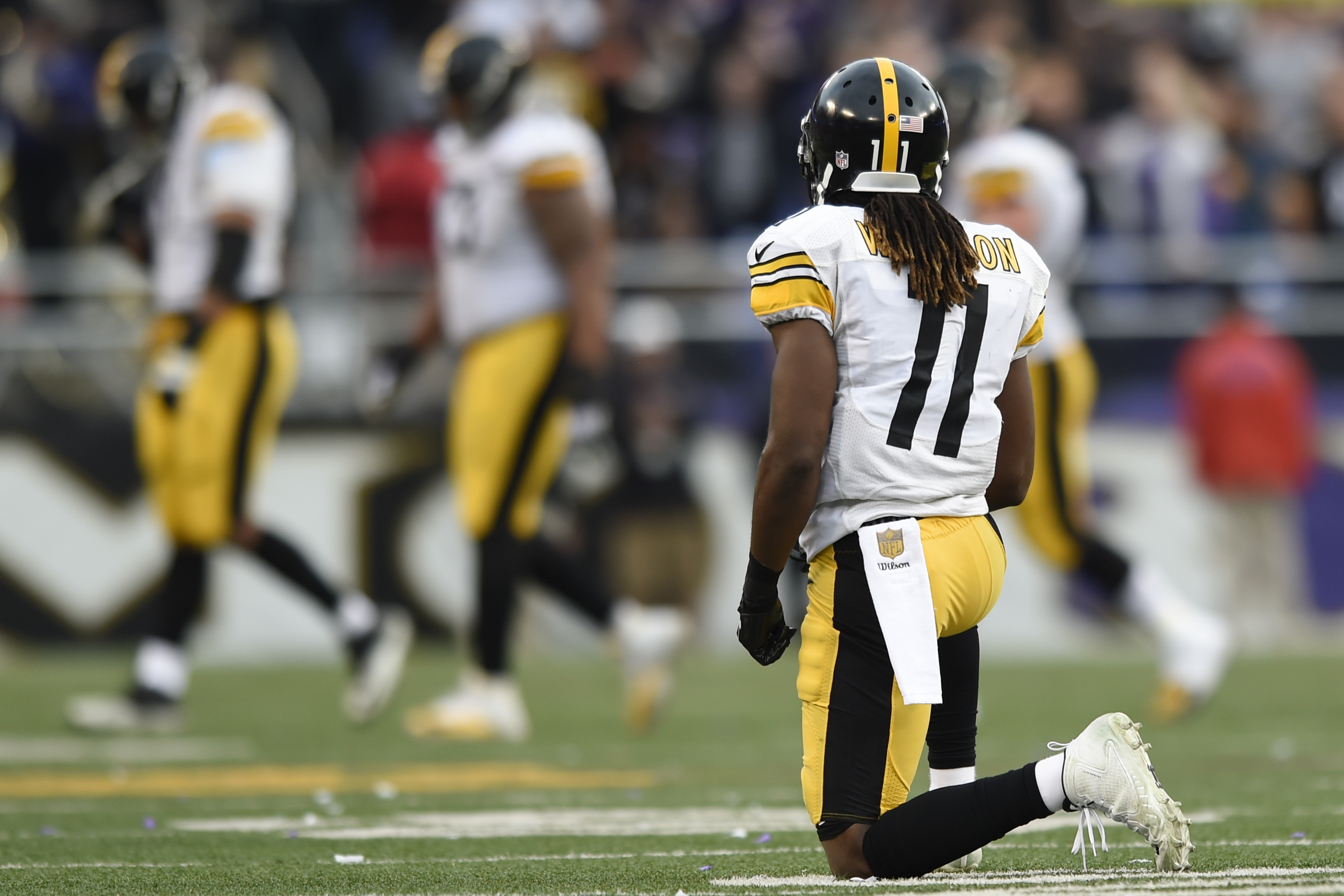 Pittsburgh Steelers wide receiver Markus Wheaton (11) kneels on the field after failing to catch a pass in the closing minutes of an NFL football game against the Baltimore Ravens in Baltimore, Sunday, Dec. 27, 2015. The Ravens defeated the Steelers 20-17