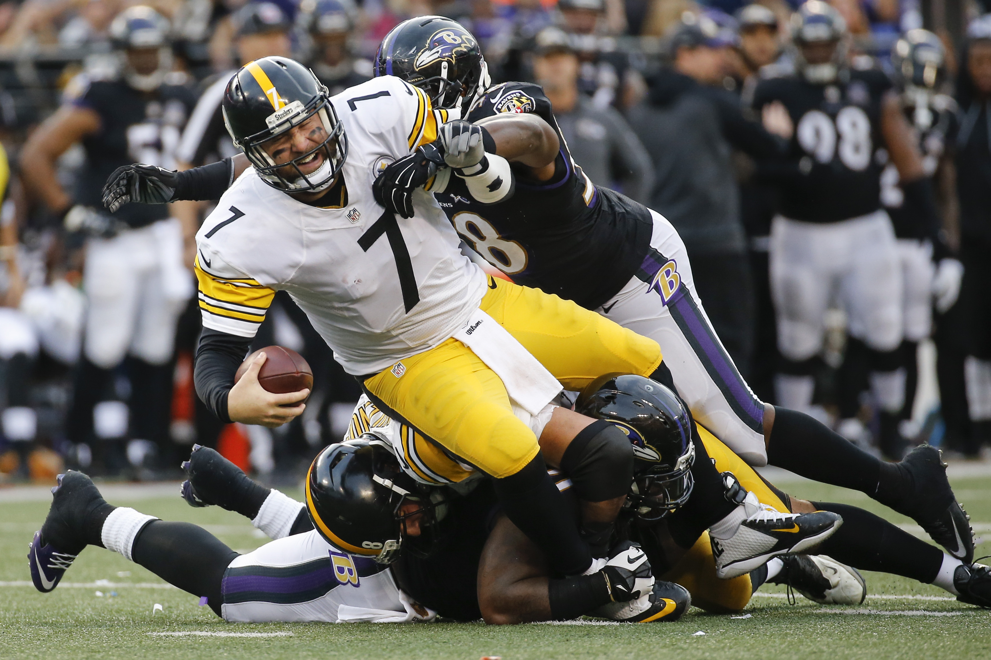 Pittsburgh Steelers quarterback Ben Roethlisberger (7) is sacked by Baltimore Ravens outside linebacker Elvis Dumervil (58) during the second half of an NFL football game in Baltimore, Sunday, Dec. 27, 2015. The Ravens defeated the Steelers 20-17. (AP Pho