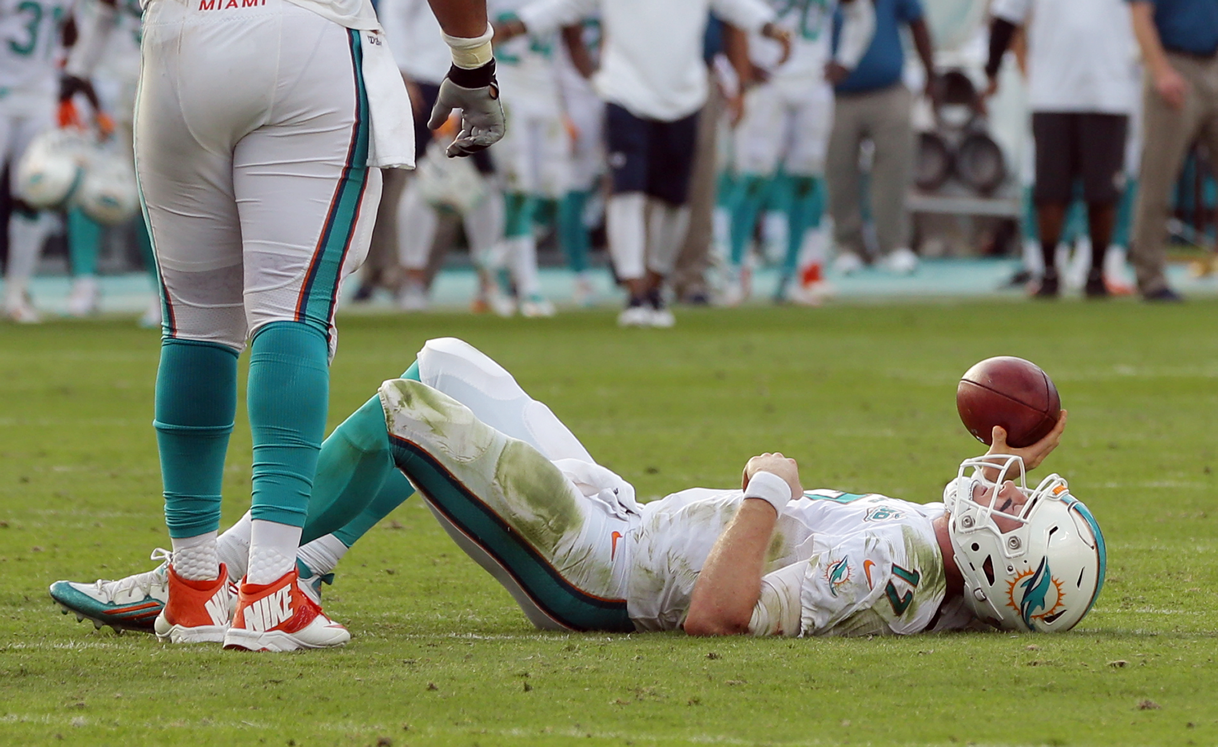 Miami Dolphins quarterback Ryan Tannehill (17) lies on the field after a sack during the final seconds of the second half of an NFL football game against the Indianapolis Colts, Sunday, Dec. 27, 2015, in Miami Gardens, Fla. The Colts defeated the Dolphins
