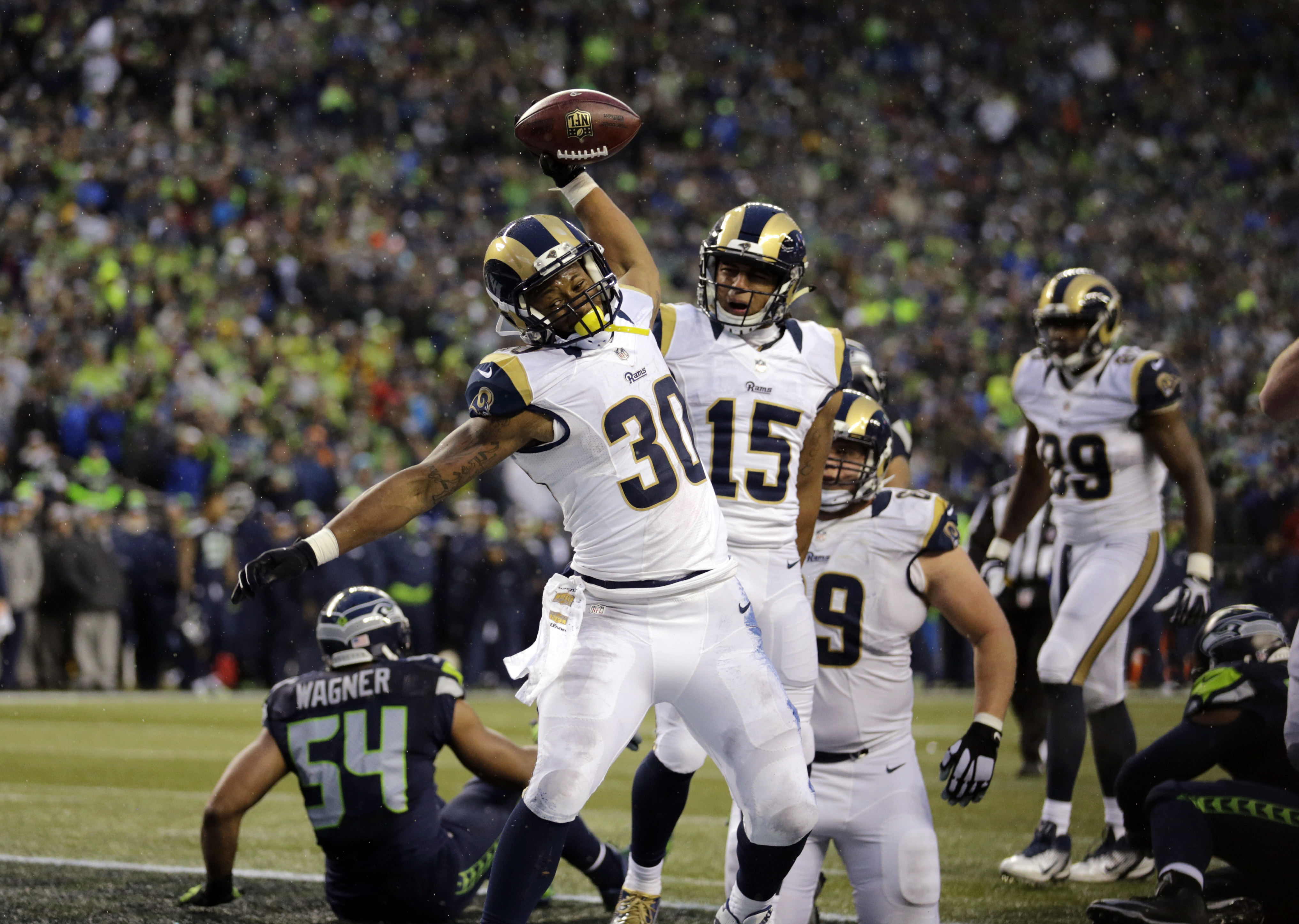 St. Louis Rams' Todd Gurley (30) spikes the ball after scoring a touchdown on a run against the Seattle Seahawks in the second half of an NFL football game, Sunday, Dec. 27, 2015, in Seattle. (AP Photo/Stephen Brashear)