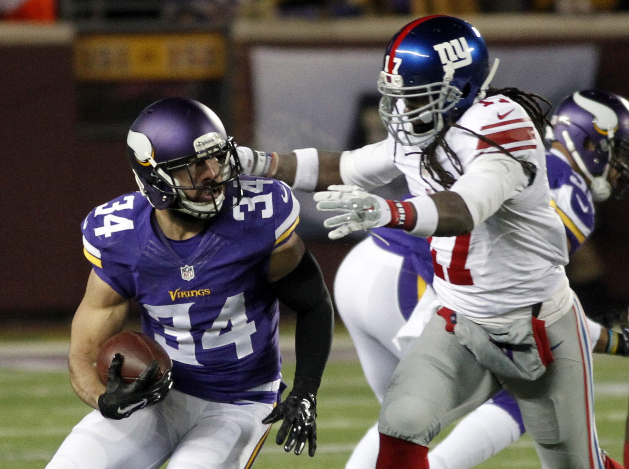 Minnesota Vikings strong safety Andrew Sendejo (34) is tackled by New York Giants wide receiver Dwayne Harris (17) after Sendejo intercepted a pass during the first half of an NFL football game Sunday, Dec. 27, 2015, in Minneapolis. (AP Photo/Andy Clayton
