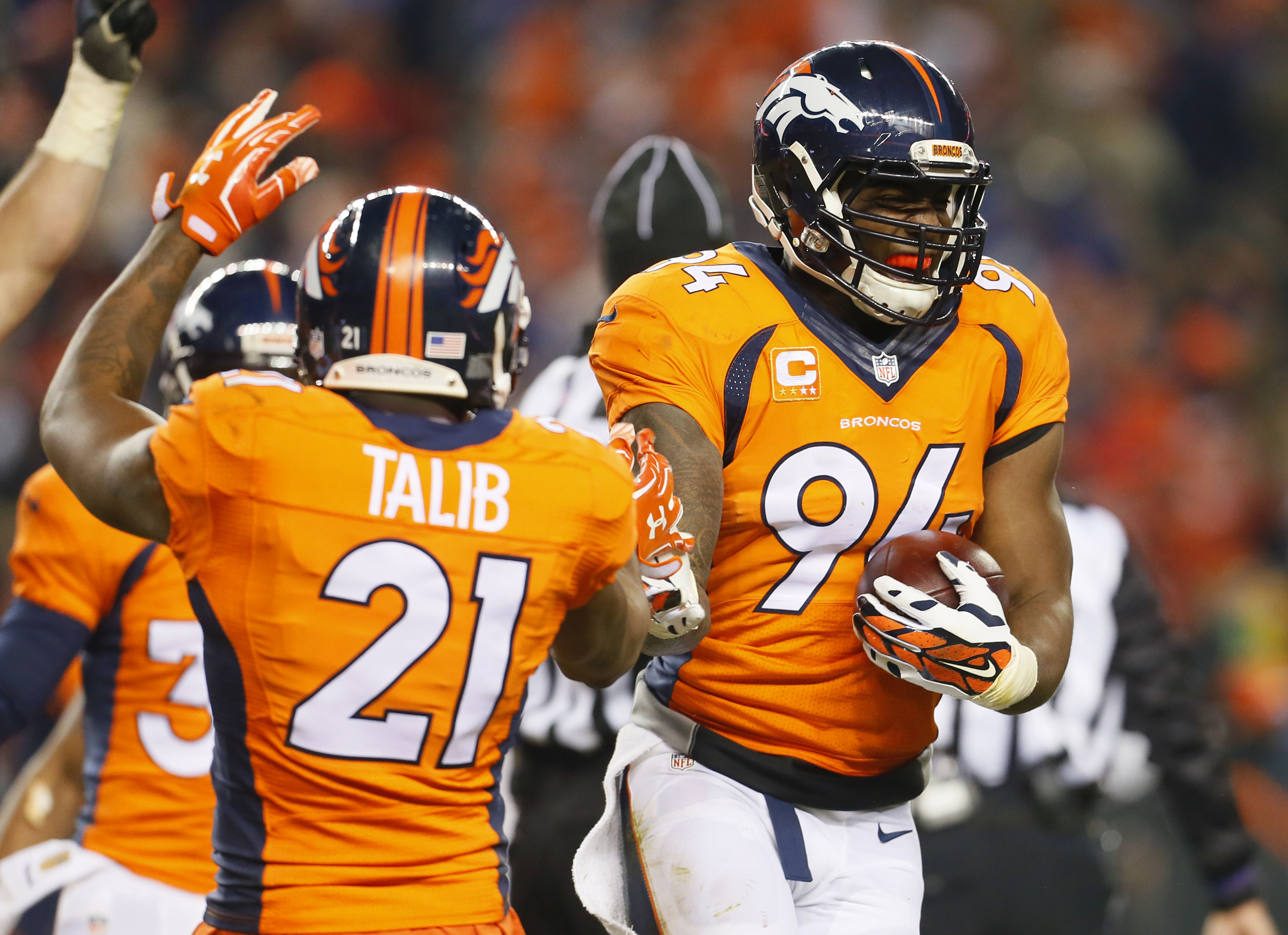 Denver Broncos outside linebacker DeMarcus Ware (94) celebrates his fumble recovery for the win after an NFL football game against the Cincinnati Bengals, Monday, Dec. 28, 2015, in Denver. The Broncos won 20-17 in overtime. (AP Photo/Joe Mahoney)