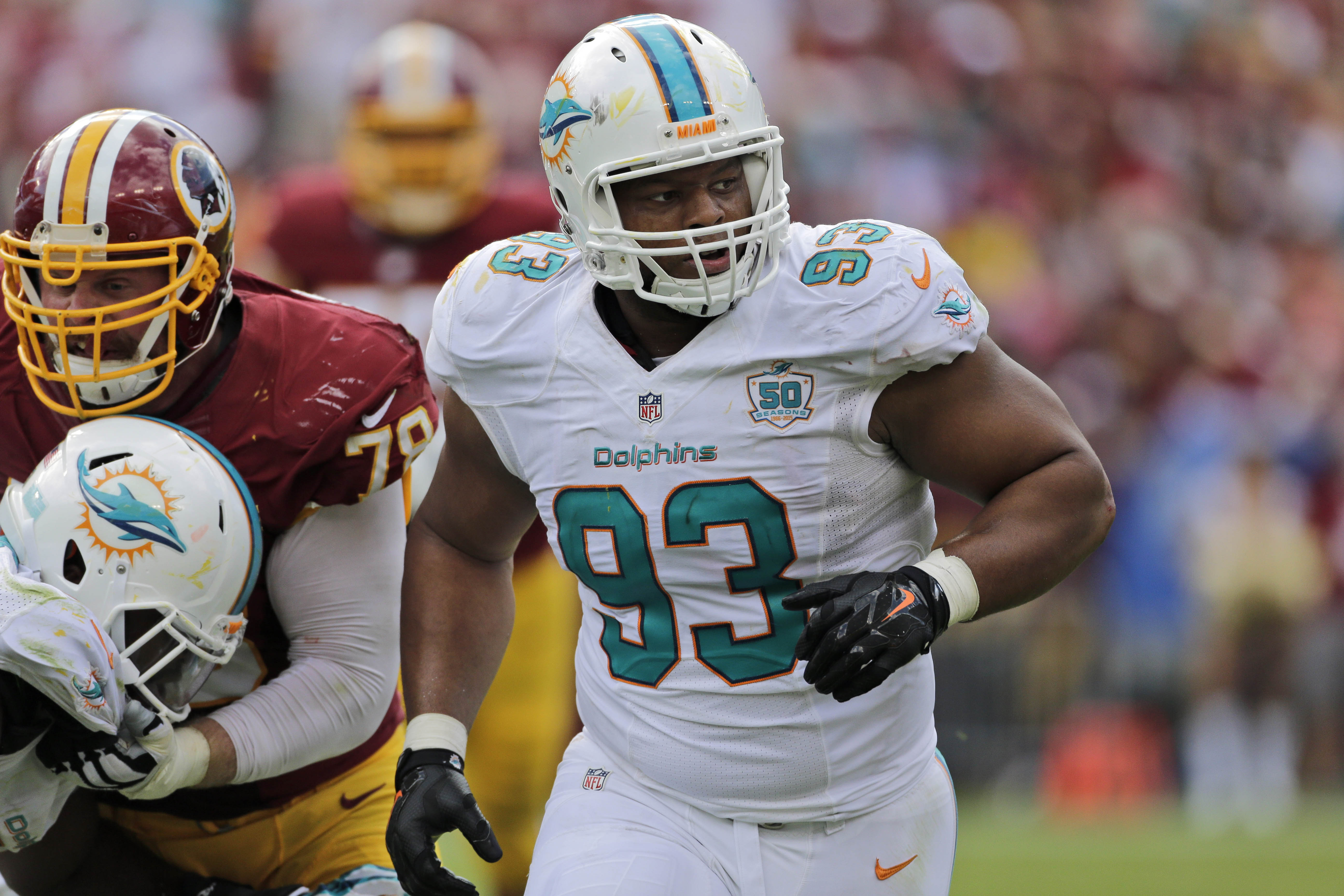 FILE - In this Sunday, Sept. 13, 2015 file photo, Miami Dolphins defensive tackle Ndamukong Suh (93) rushes during the second half of an NFL football game against the Washington Redskins in Landover, Md. The 2015 NFL season has had plenty of flops such as