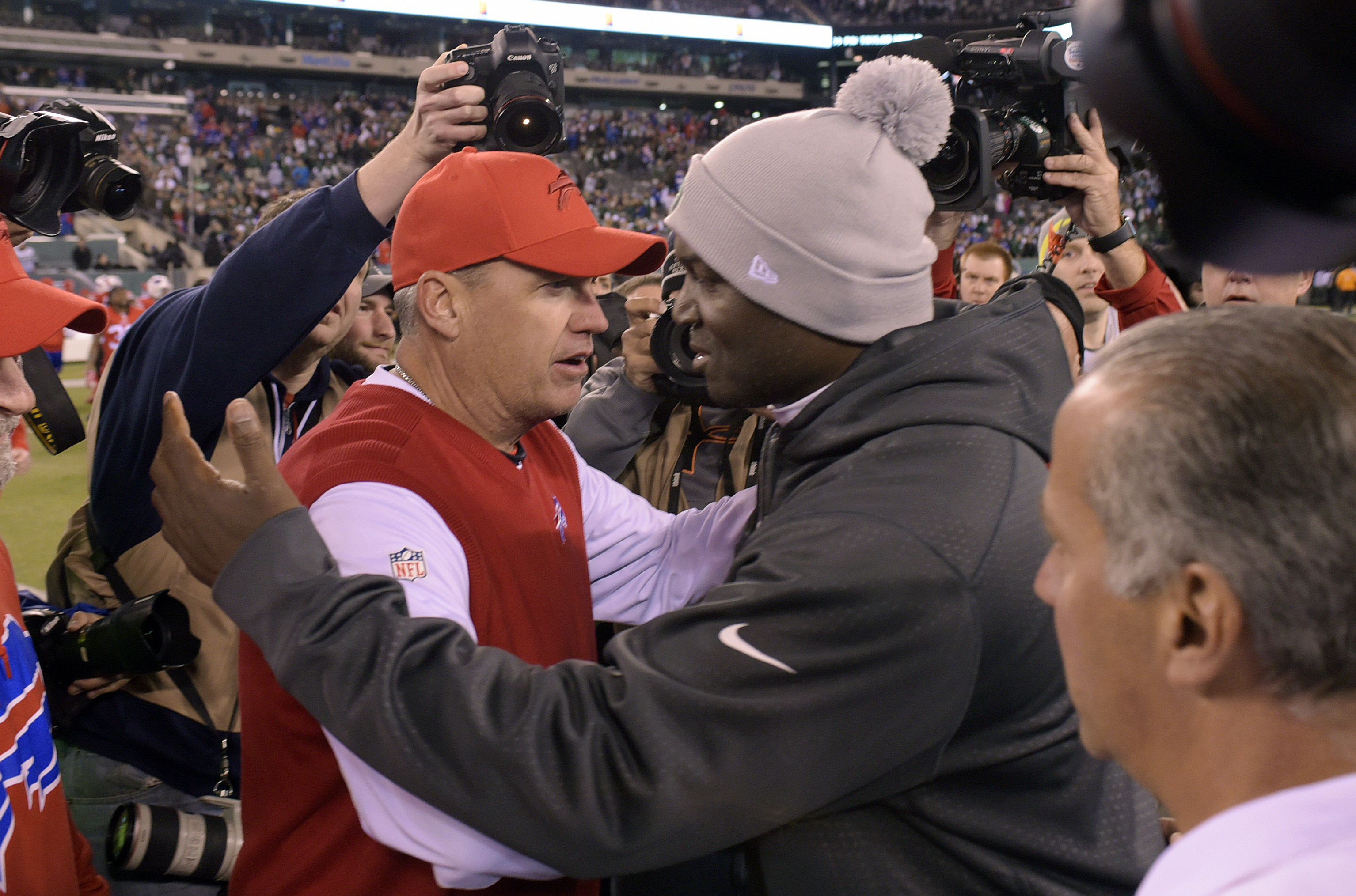 FILE - In this Nov. 12, 2015, file photo, Buffalo Bills head coach Rex Ryan, left, and New York Jets head coach Todd Bowles talk after the Bills won 22-17 in an NFL football game in East Rutherford, N.J. The two teams meet on Sunday, with a playoff spot o