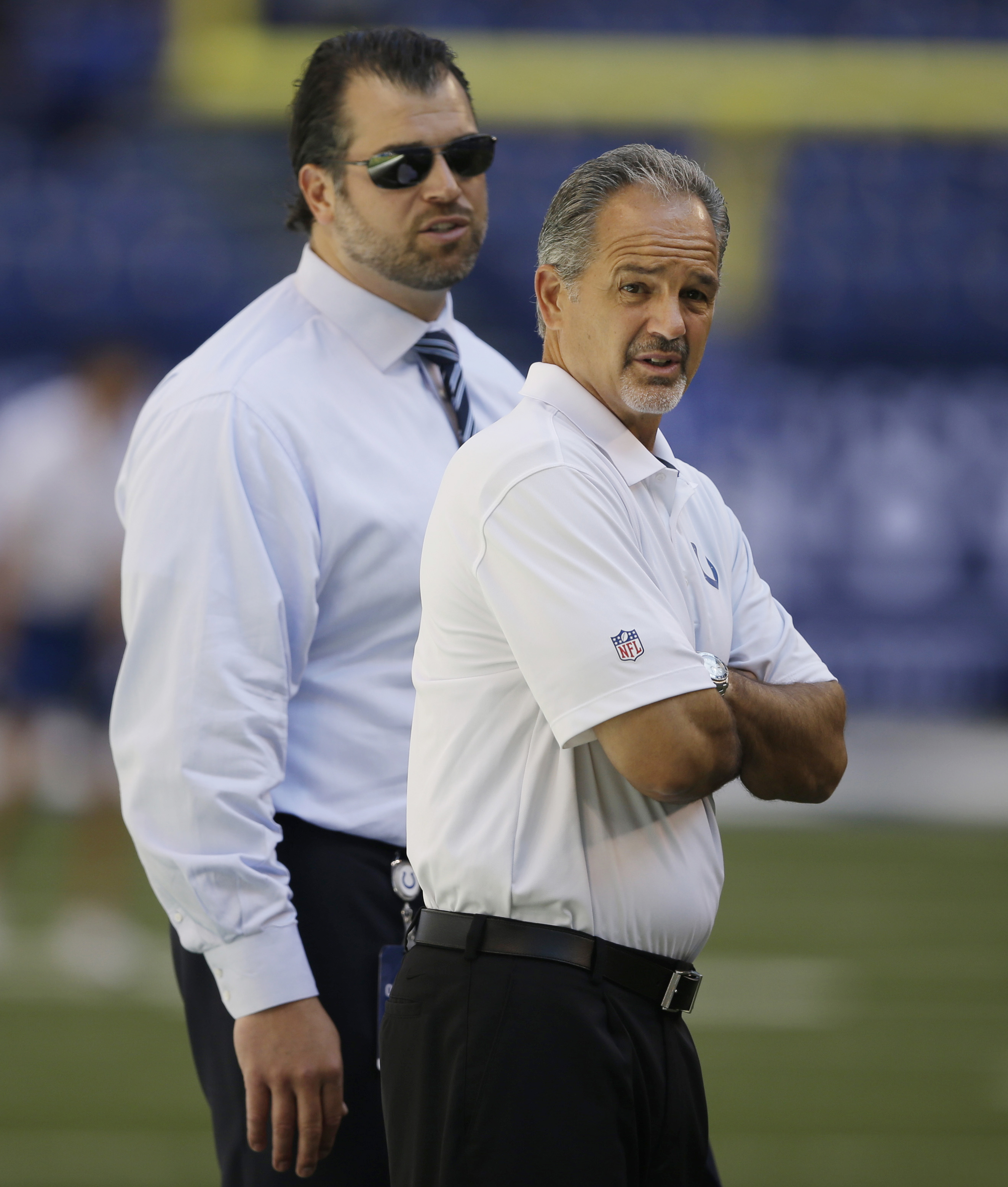 FILE - In this Sept. 28, 2014, file phot,o Indianapolis Colts general manager Ryan Grigson, left, and head coach Chuck Pagano walk on the field before an NFL football game against  the Tennessee Titans in Indianapolis. Pagano's contract is about to expire