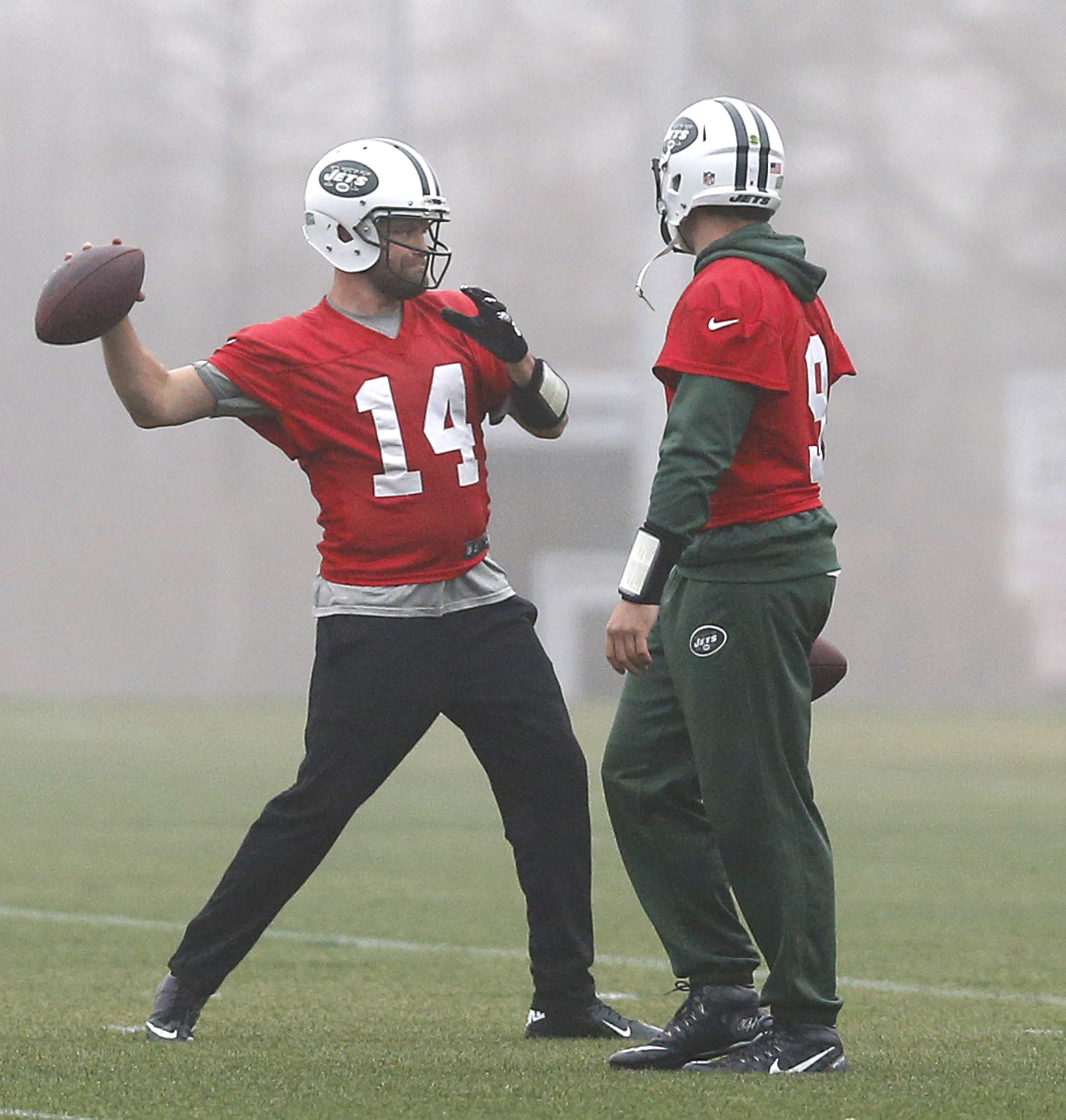 New York Jets quarterback Ryan Fitzpatrick (14) throws a pass during a workout as quarterback Bryce Petty (9) watches during NFL football practice, Wednesday, Dec. 30, 2015, in Florham Park, N.J.  The Jets are preparing for Sunday's game against the Buffa