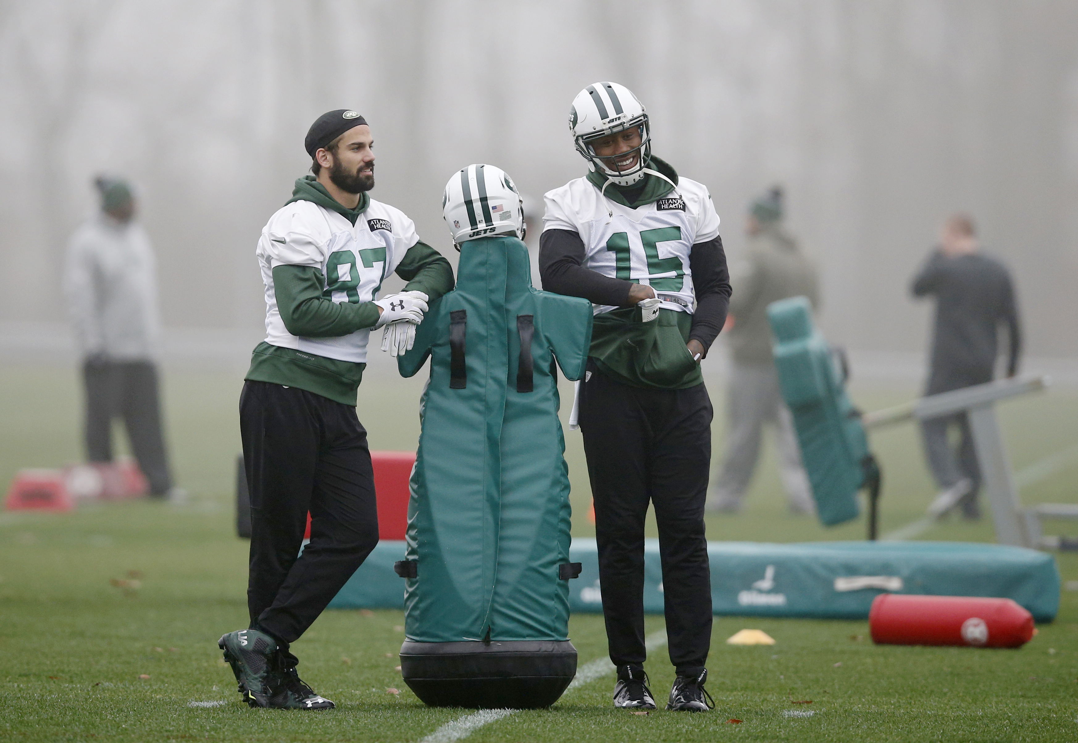New York Jets wide receivers Eric Decker (87) and Brandon Marshall (15) lean on blocking dummy before NFL football practice, Wednesday, Dec. 30, 2015, in Florham Park, N.J.   The Jets are preparing for Sunday's game against the Buffalo Bills and former co