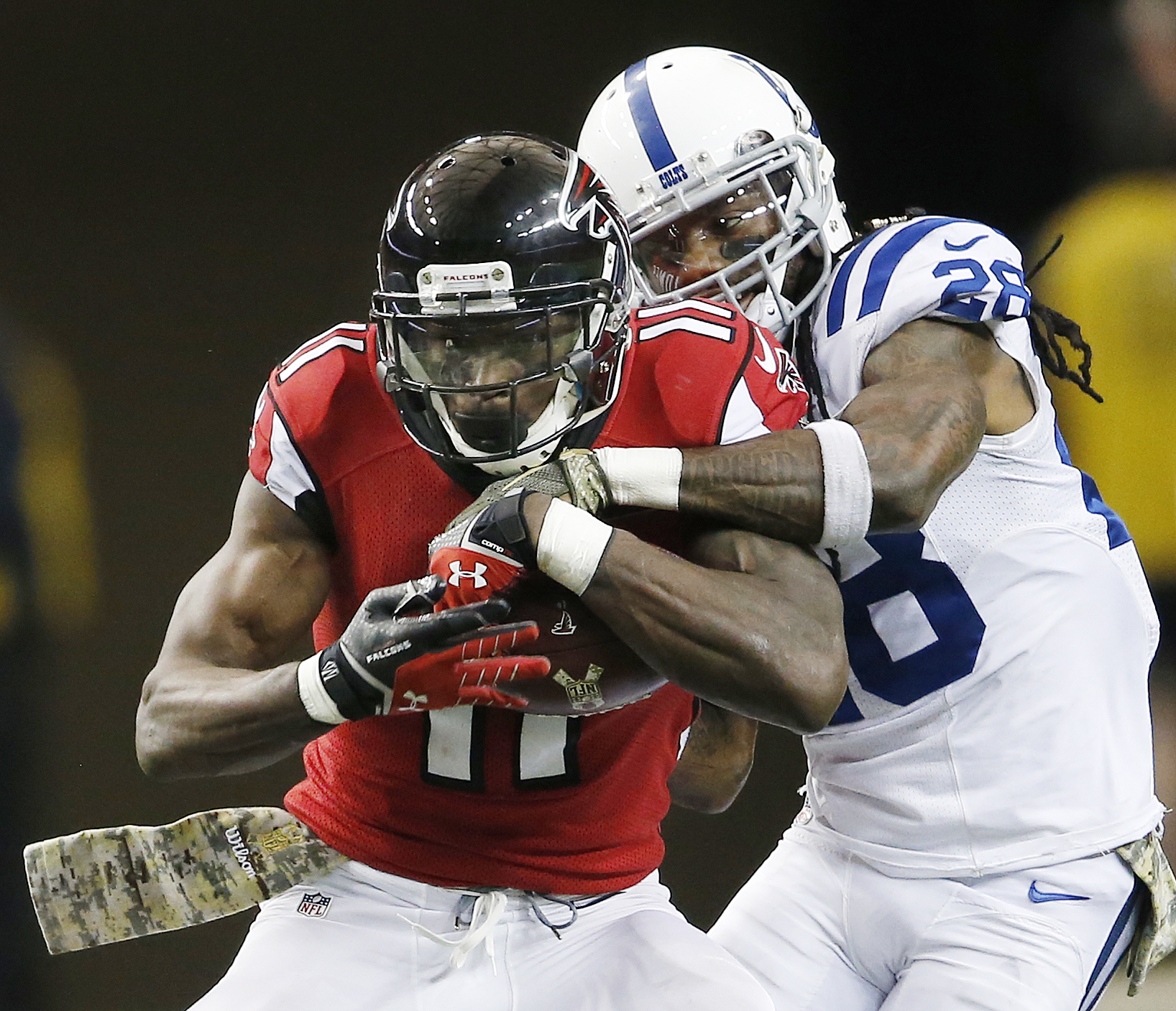 FILE - In this Nov. 22, 2015, file photo, Atlanta Falcons wide receiver Julio Jones (11) makes the catch against Indianapolis Colts cornerback Greg Toler (28) during the second half of an NFL football game in Atlanta. The New Orleans Saints play the Falco
