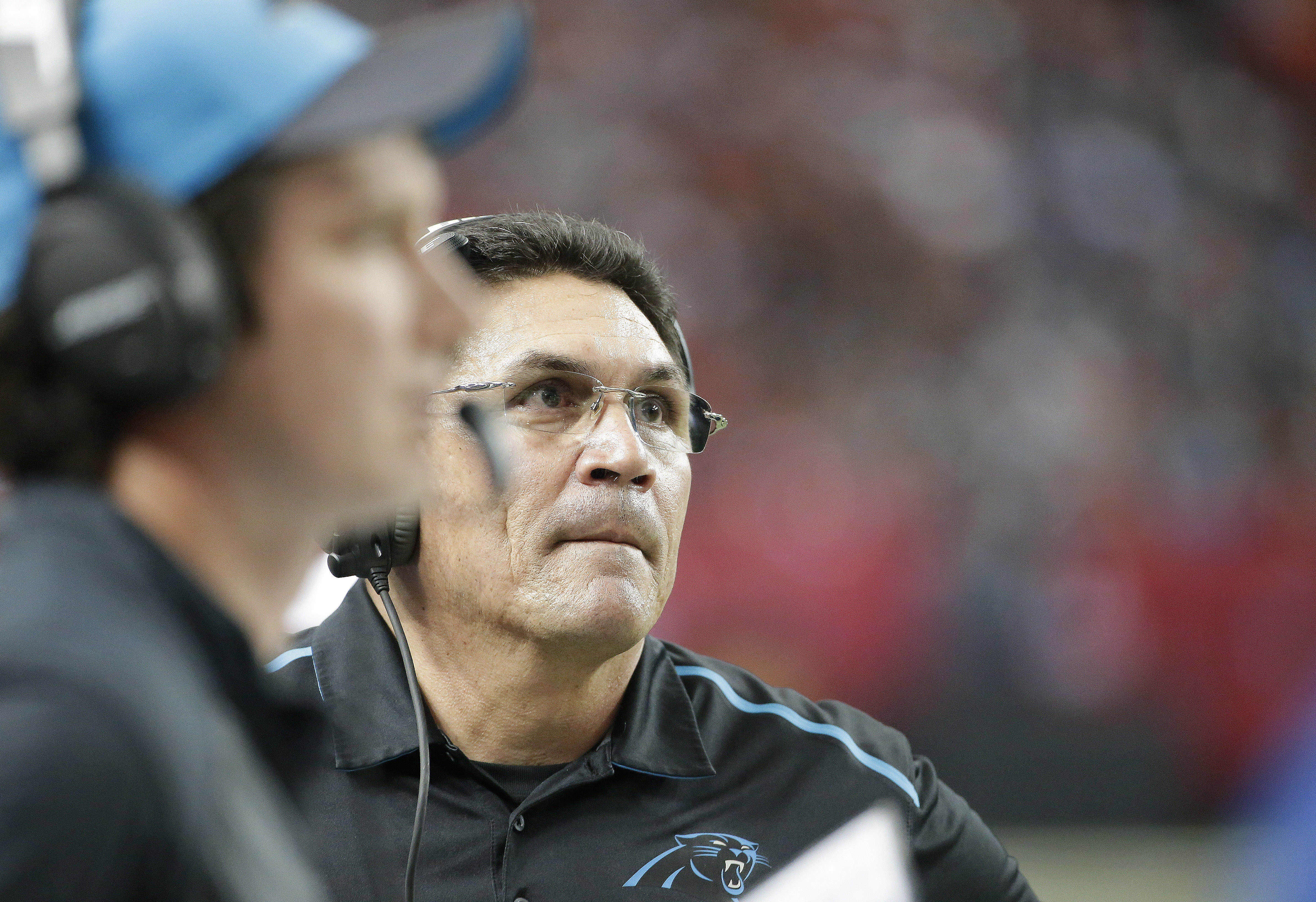 FILE - In this Sunday, Dec. 27, 2015, file photo, Carolina Panthers head coach Ron Rivera watches his team play against the Atlanta Falcons during the first half of an NFL football game in Atlanta. Rivera, who is 18-4 in December games, said he believes h
