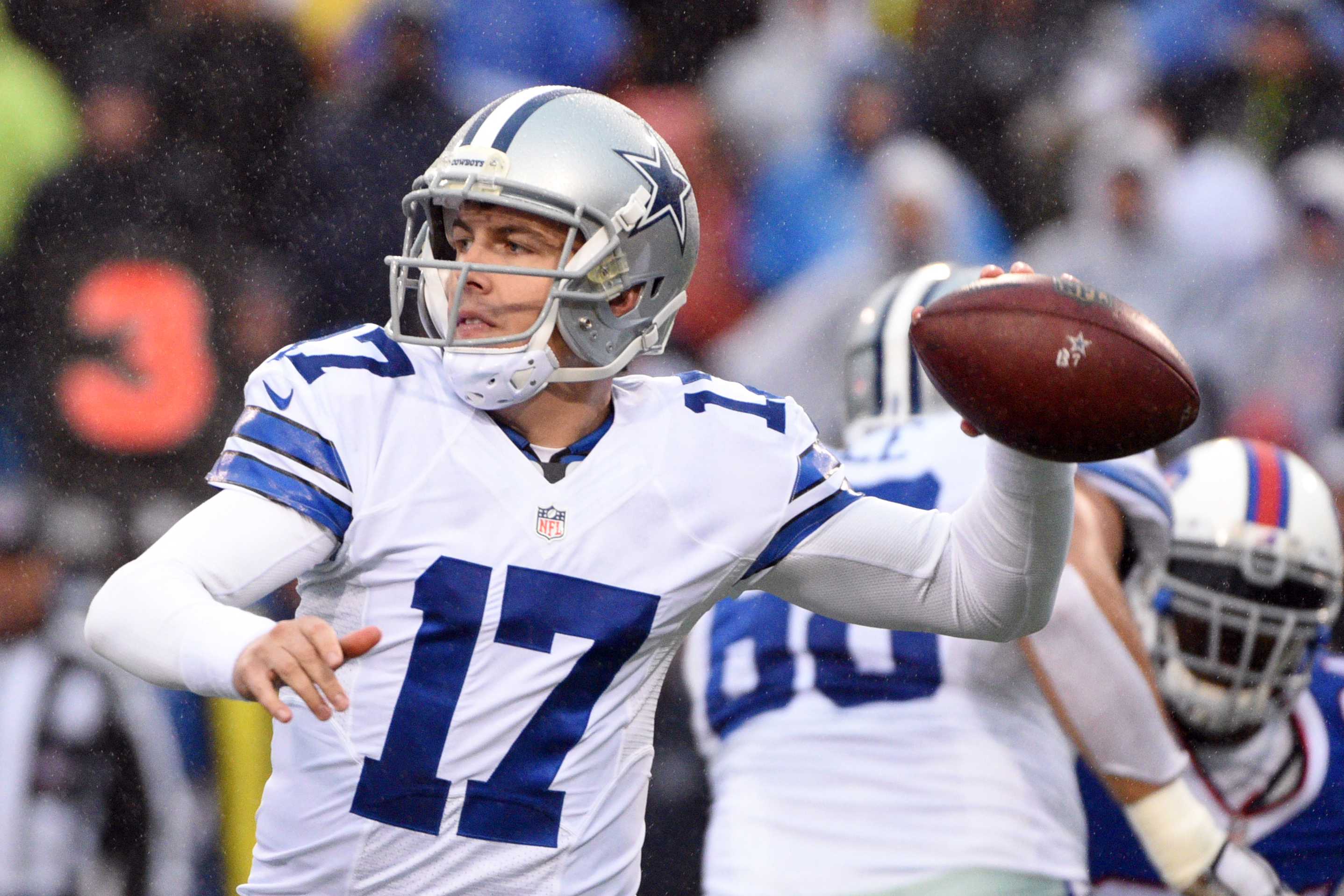 FILE - In this Dec. 27, 2015, file photo, Dallas Cowboys quarterback Kellen Moore throws against the Buffalo Bills during the second half of an NFL football game in Orchard Park, N.Y. The Cowboys take on the Washington Redskins on Sunday. (AP Photo/Gary W