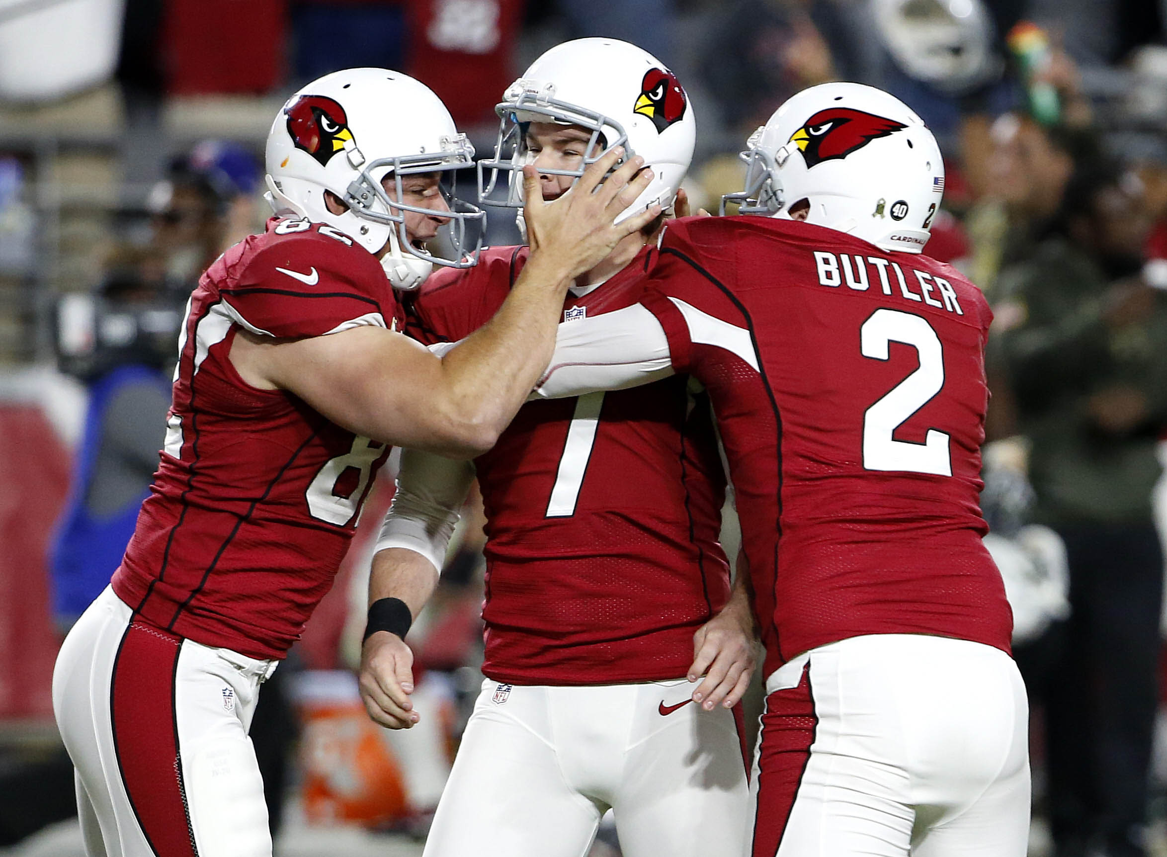 FILE - In this Nov. 22, 2015 file photo, Arizona Cardinals kicker Chandler Catanzaro (7) celebrates his game-winning field goal with punter Drew Butler (2) and snapper Mike Leach (82) against the Cincinnati Bengals during the second half of an NFL footbal
