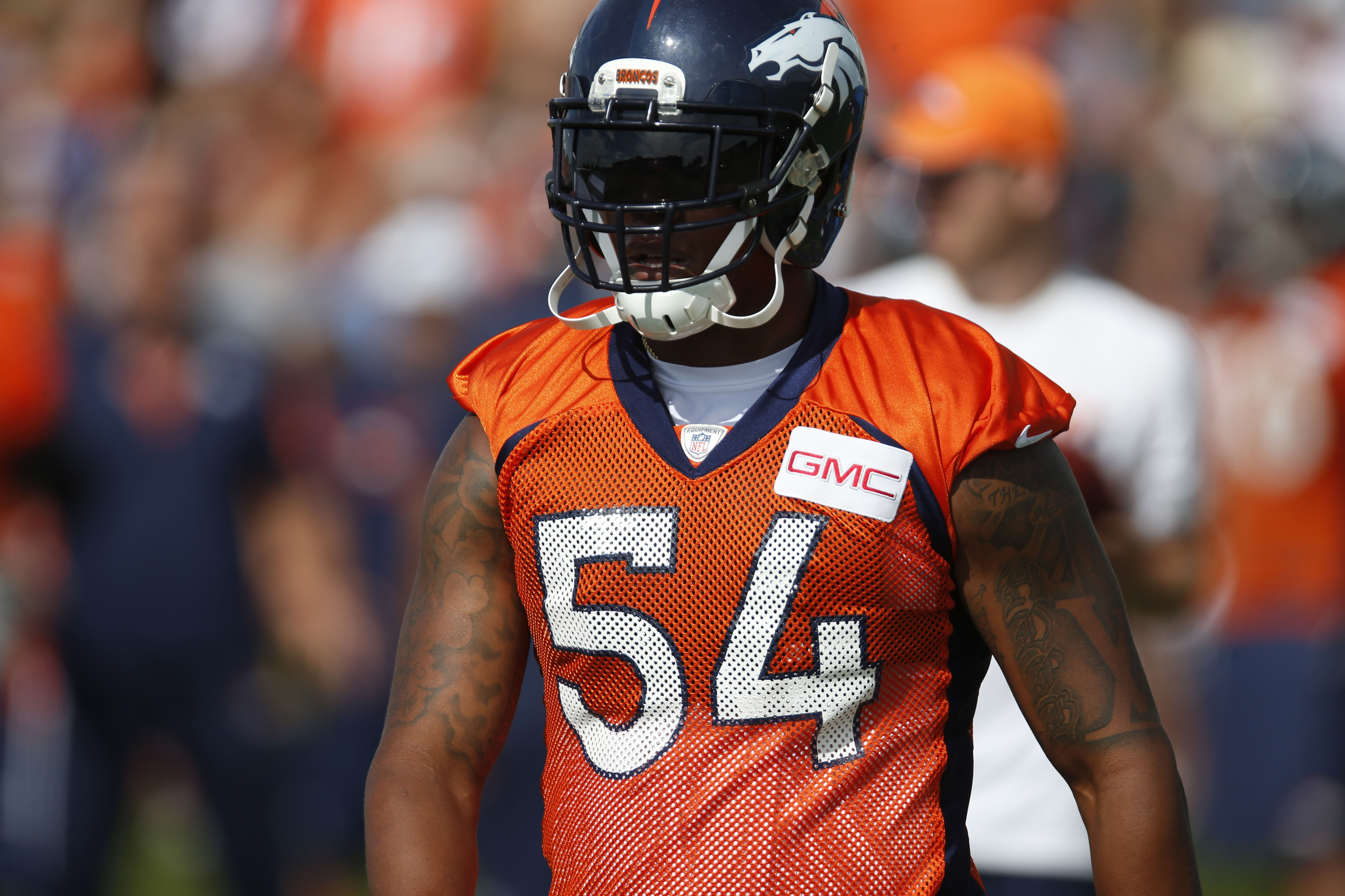 In this photo taken Friday, Aug. 7, 2015, Denver Broncos outside linebacker Brandon Marshall takes a break from drills at the team's NFL football training camp in Englewood, Colo. Marshall, who is the top tackler on the top-ranked defense in the NFL, coul