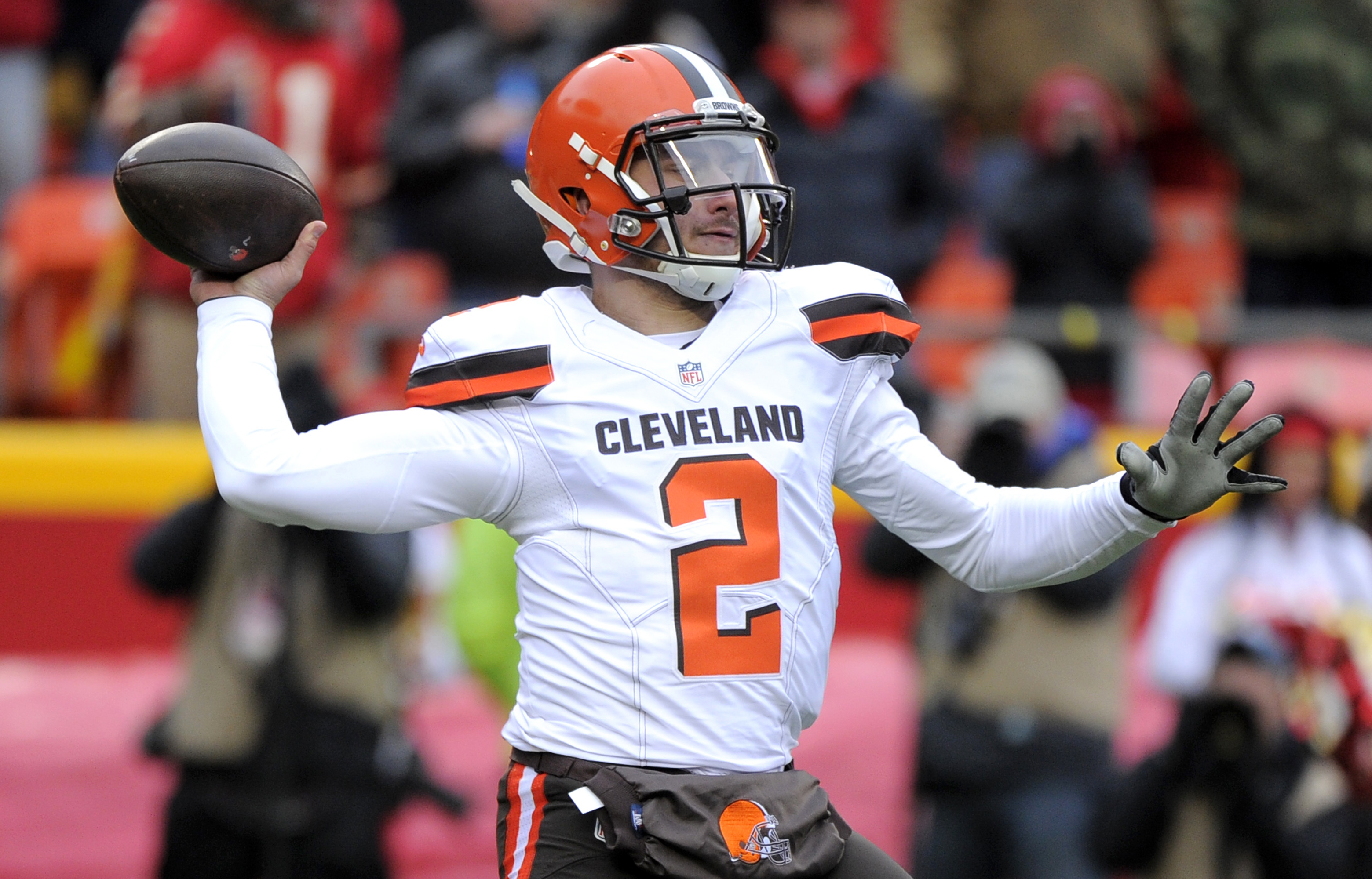 FILE - In this Dec. 27, 2015, file photo, Cleveland Browns quarterback Johnny Manziel (2) throws during the first half of an NFL football game against the Kansas City Chiefs in Kansas City, Mo. Manziel's footwork, decision making and grasp of a pro offens