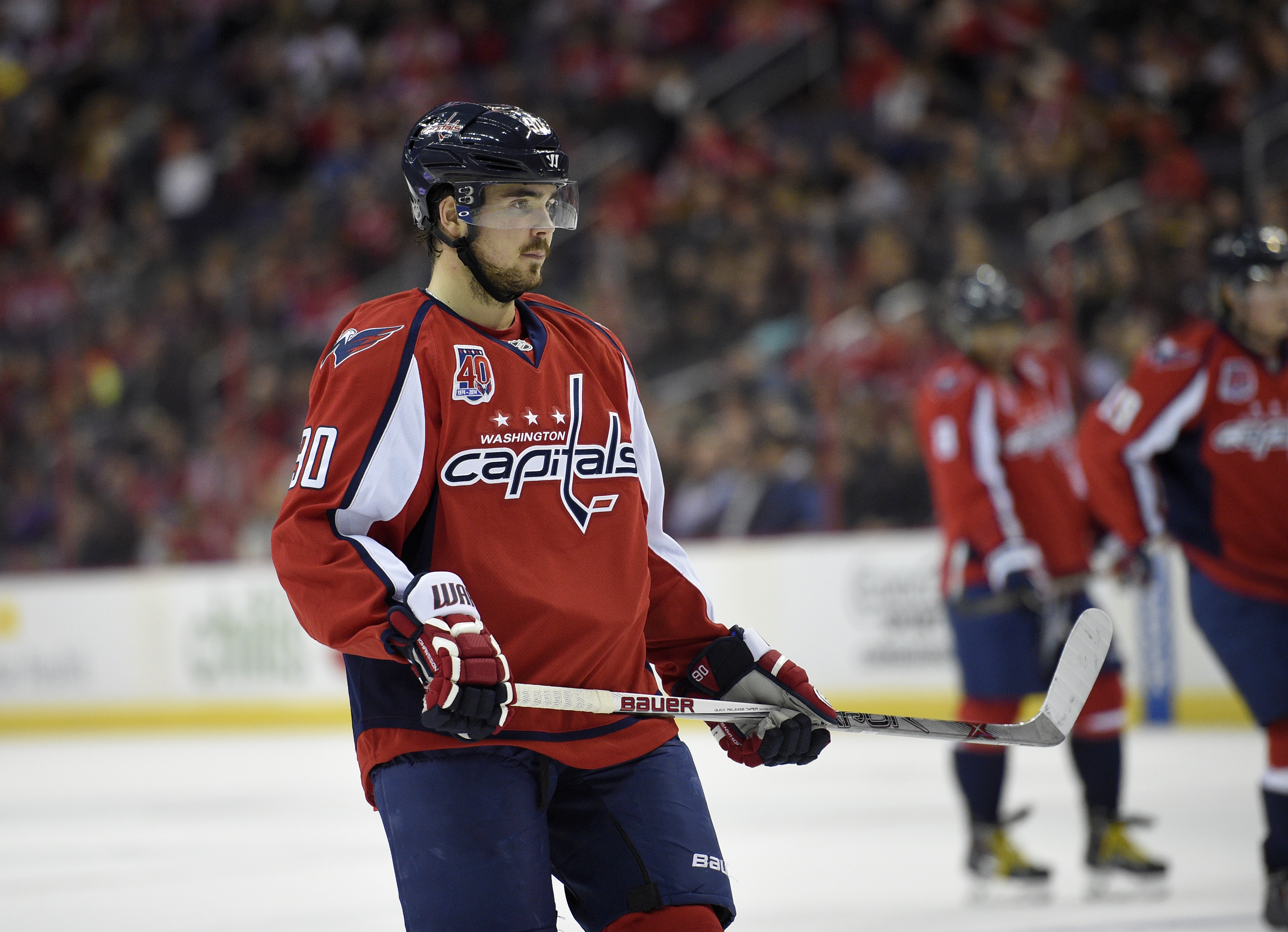 Washington Capitals left wing Marcus Johansson (90), of Sweden, looks on during the first period of an NHL hockey game against the Colorado Avalanche, Monday, Jan. 12, 2015, in Washington. (AP Photo/Nick Wass)