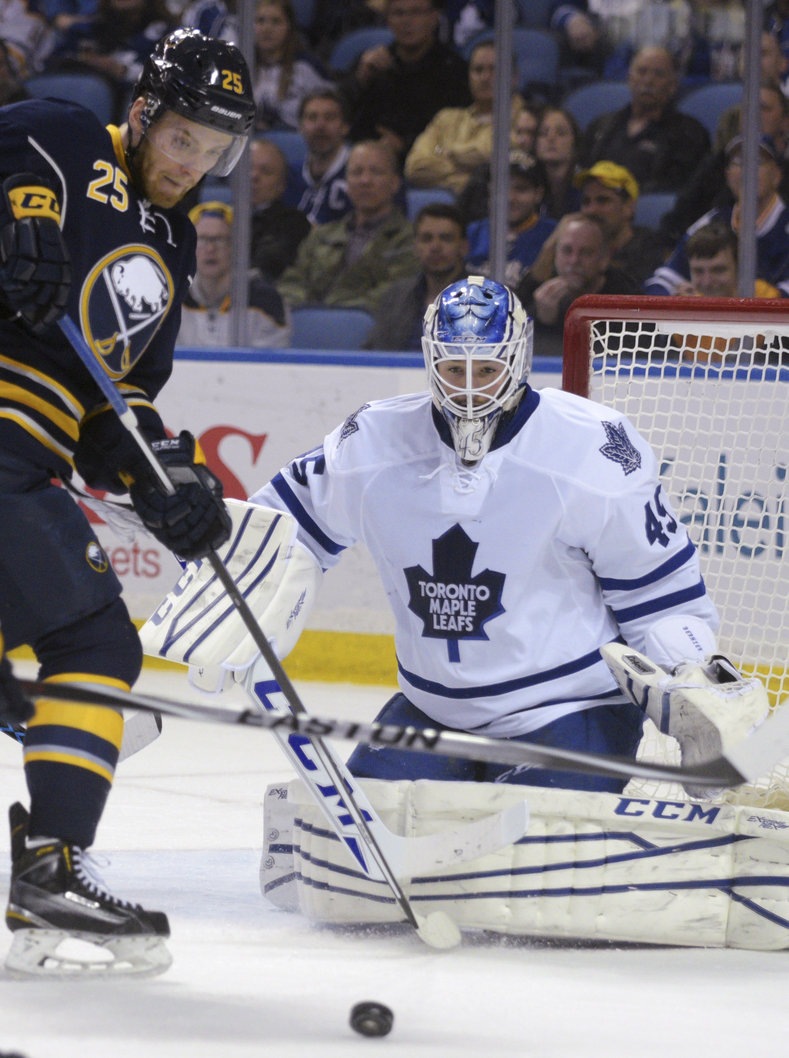 Buffalo Sabres center Mikhail Grigorenko (25), of Russia, watches the puck after a save by Toronto Maple Leafs goaltender Jonathan Bernier during the first period of an NHL hockey game Wednesday, April 1, 2015, in Buffalo, N.Y. Buffalo won 4-3. (AP Photo/