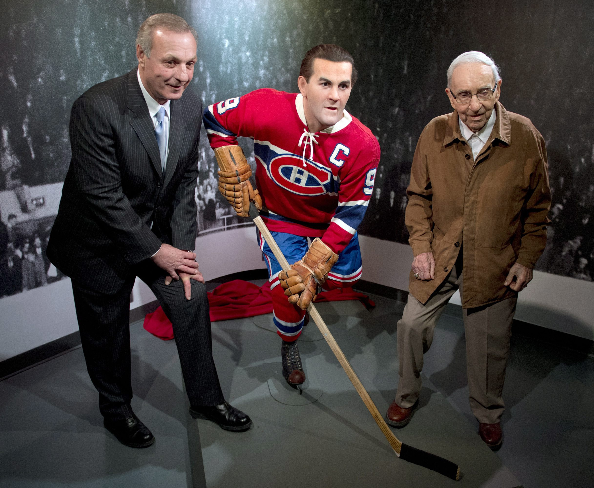 """FILE - In this April 10, 2014, file photo, former Montreal Canadiens Guy Lafleur, left, and Bob Fillion, right, pose with a wax statue of Maurice """"Rocket"""" Richard at the unveiling at the Montreal Canadiens Hall of Fame in Montreal. Fillion, who won the St"""