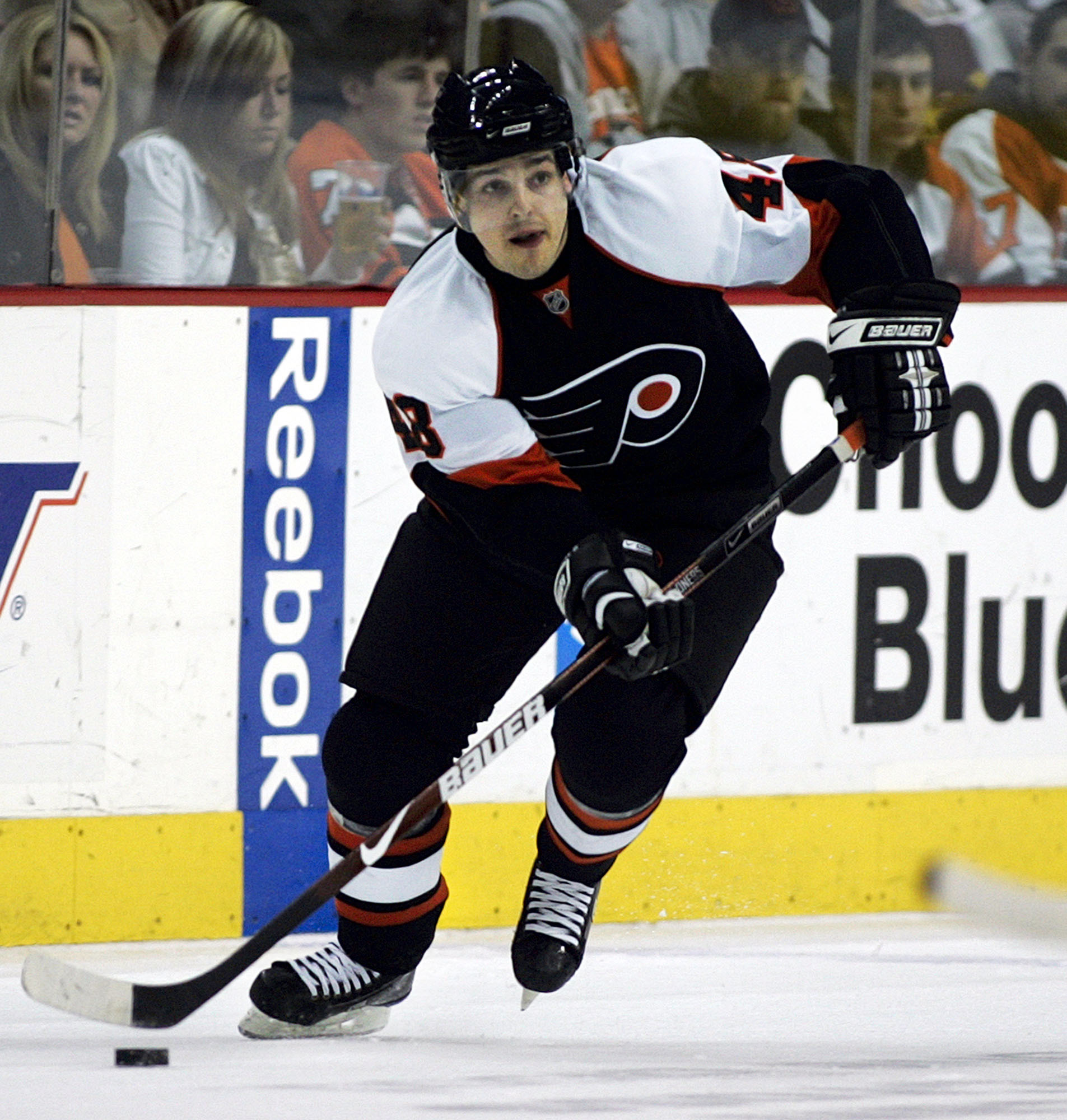 FILE - In this March 5, 2009, file photo, Philadelphia Flyers center Daniel Briere moves the puck up ice in the second period of an NHL hockey game against the Calgary Flames in Philadelphia. Briere, the undersized center who went on to become an NHL All-