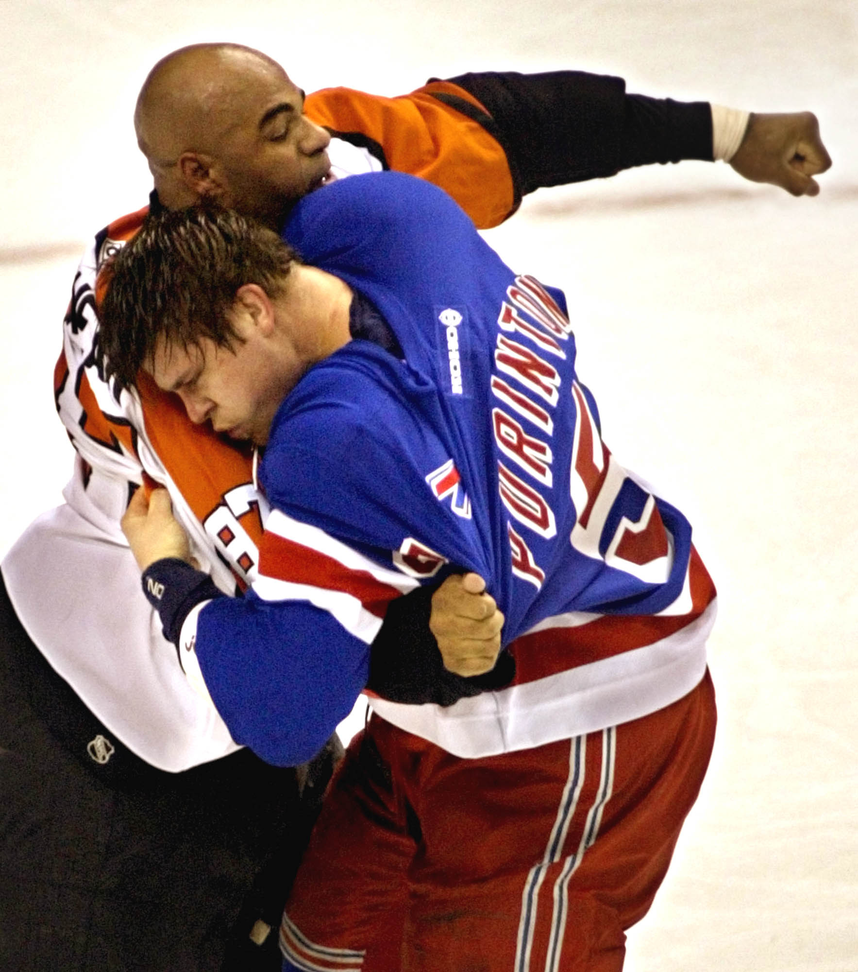 New York Rangers' Dale Purinton, right, and Philadelphia Flyers' Donald Brashear battle in the first period in Philadelphia Saturday, April 13, 2002.  Both received five minute penalties. (AP Photo/ Miles Kennedy)
