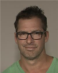 In this Aug. 20, 2015,  booking photo made available by the Anoka County Sheriff's office, Minnesota Wild NHL assistant coach Darryl Sydor is shown. Sydor has been charged with drunken driving after being arrested while taking his 12-year-old son to a hoc