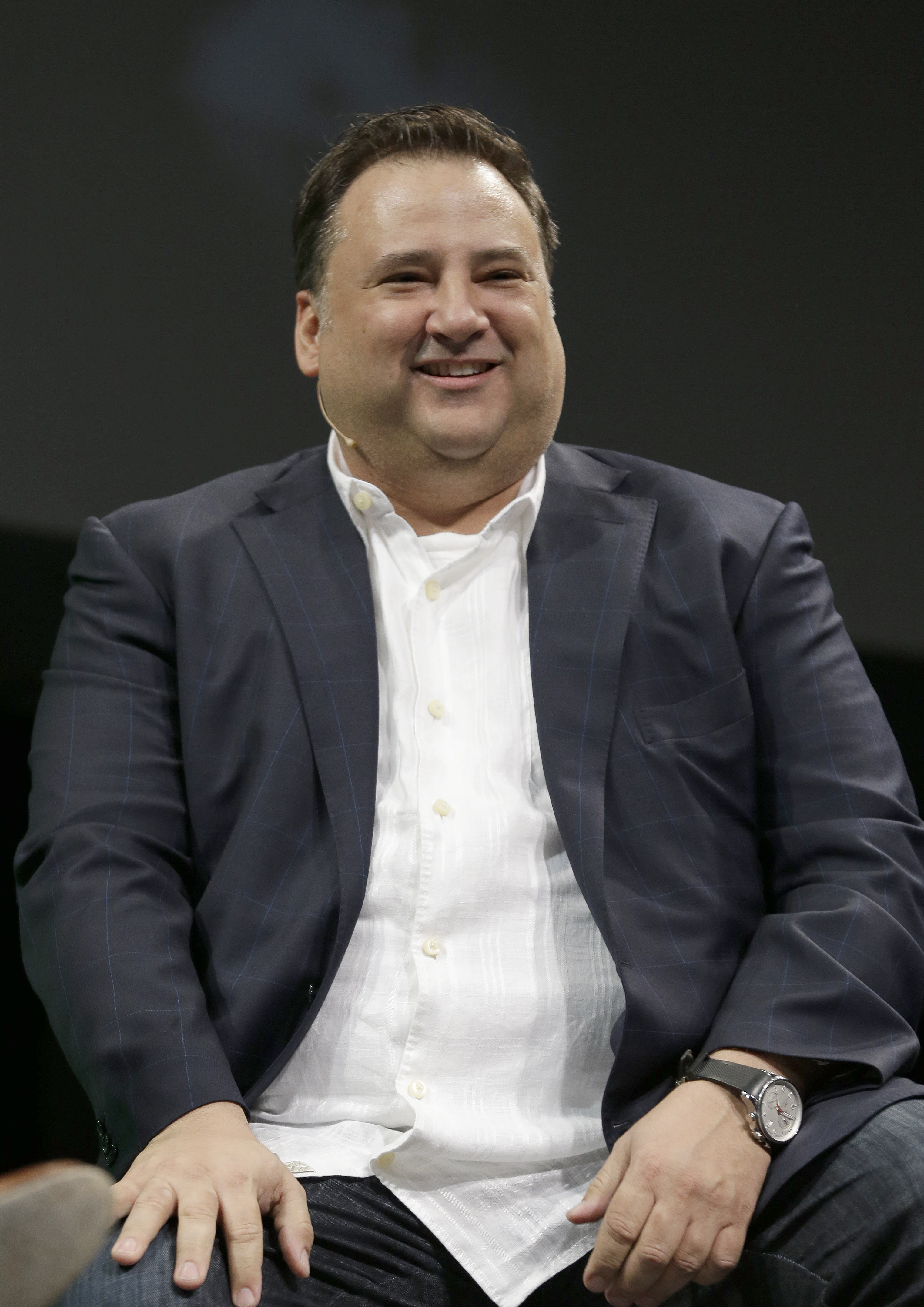 Dallas Stars owner Tom Gaglardi smiles before the team's new hockey logo unveiling in Dallas Tuesday, Sunday, June 4, 2013. (AP Photo/LM Otero)