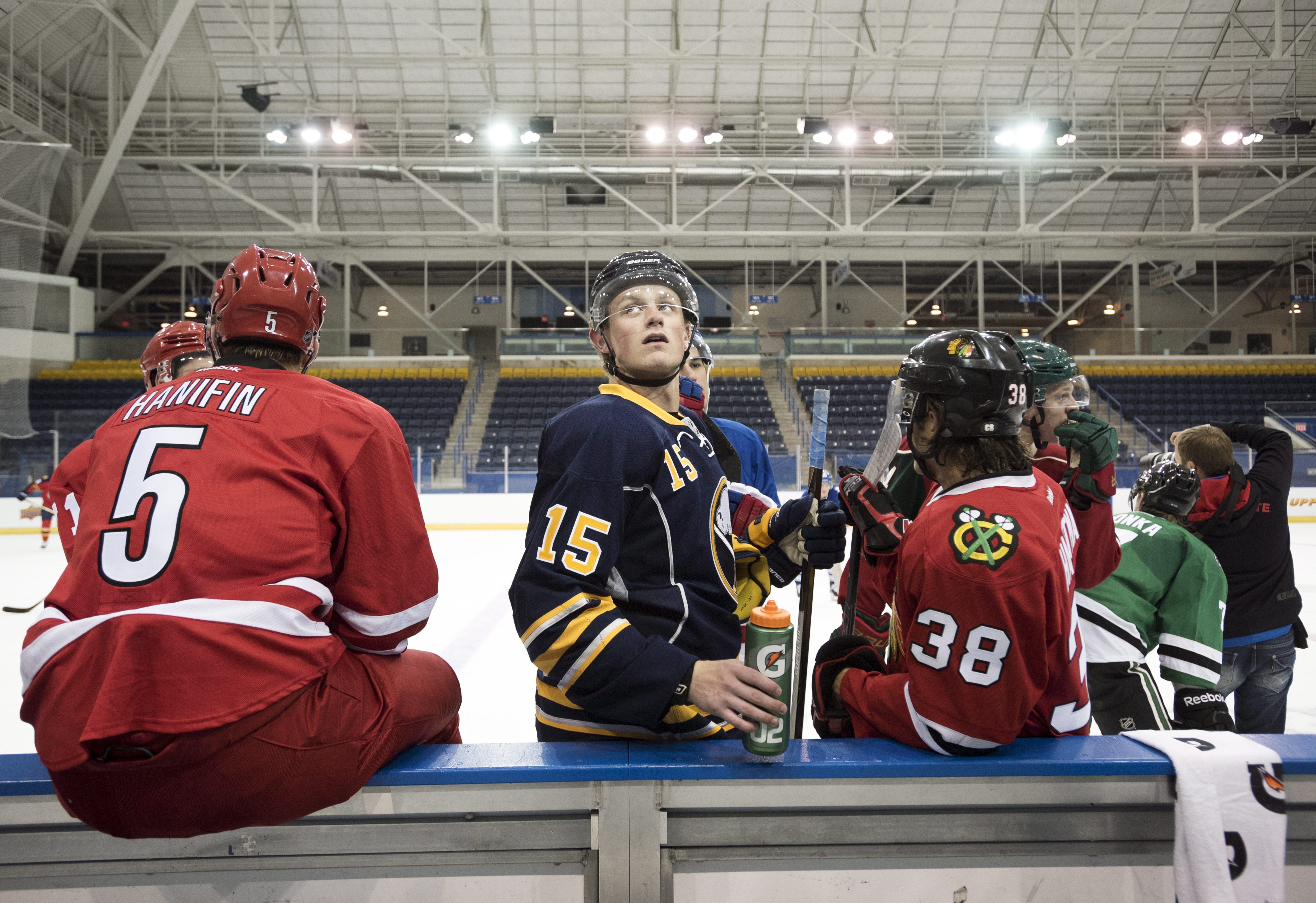 """FILE - In this Sept. 1, 2015, file photo, Buffalo Sabres' Jack Eichel, center, looks up during the National Hockey League Players Association (NHLPA) Rookie Showcase in Toronto. Sabres fans have taken a liking to """"Eich.""""  As consolations prizes go, the Sa"""
