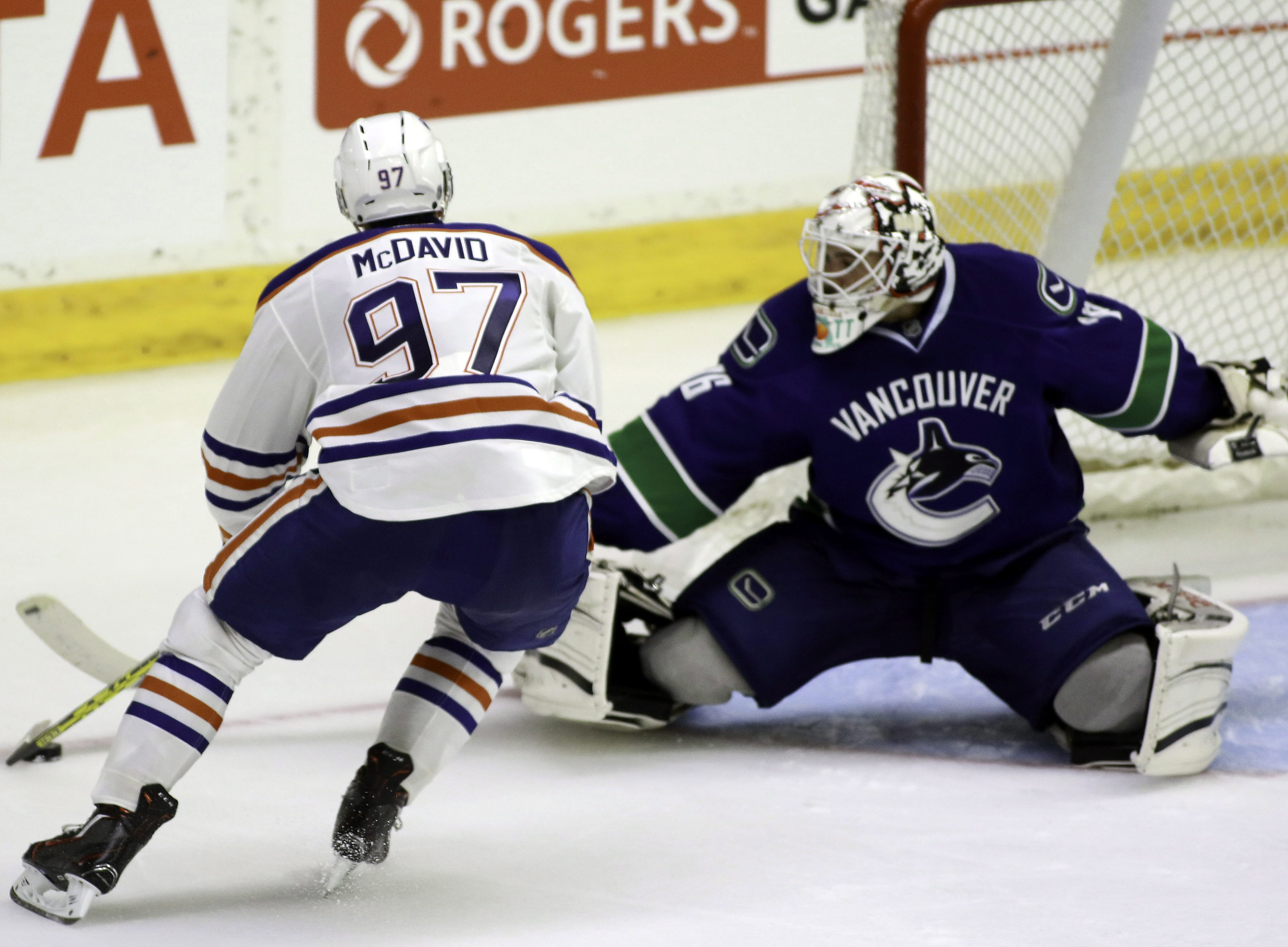 Edmonton Oliers' Connor McDavid tries to put the puck past Vancouver Canucks goaltender Clay Witt during the second period of an NHL hockey rookie tournament game Friday, Sept. 11, 2015, in Penticton, British Columbia. (Jeff Bassett/The Canadian Press via