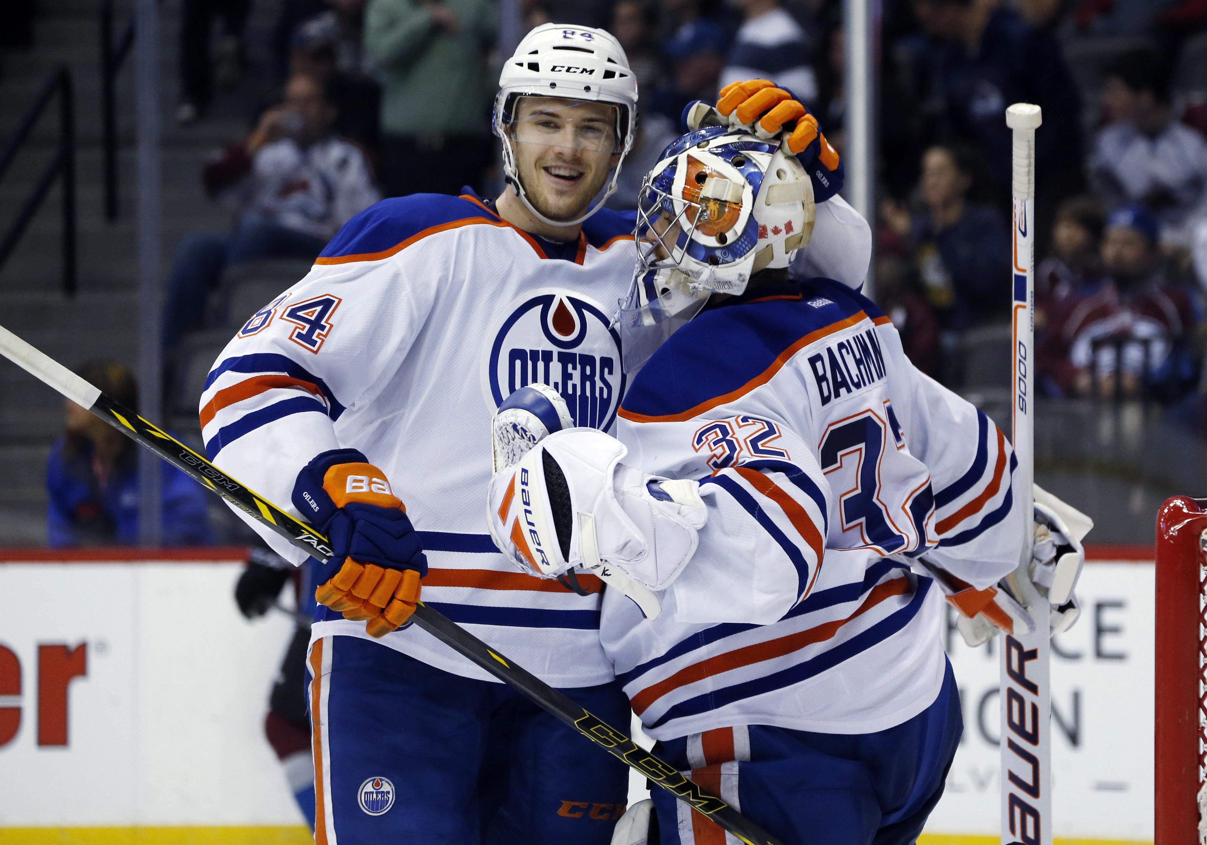 Edmonton Oilers defenseman Oscar Klefbom, left, of Sweden, congratulates goalie Richard Bachman as time runs out in the third period of an NHL hockey game against the Colorado Avalanche, Monday, March 30, 2015, in Denver. The Oilers won 4-1. (AP Photo/Dav