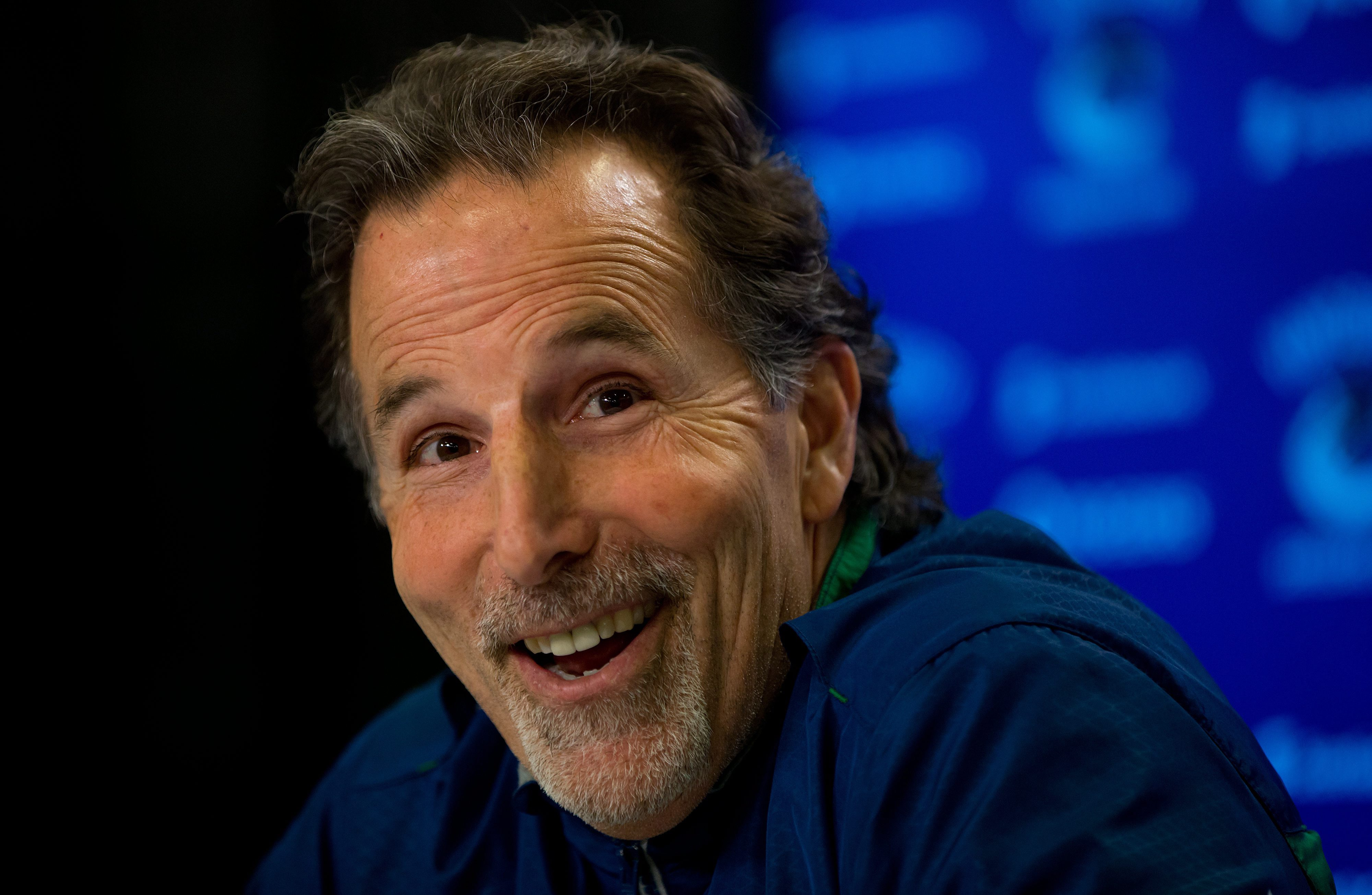 FILE - In this April 14, 2014 file photo, Vancouver Canucks' head coach John Tortorella laughs after a reporter mistakenly called him Mike during an end of season news conference in Vancouver, British Columbia.   A person familiar with the decision has co