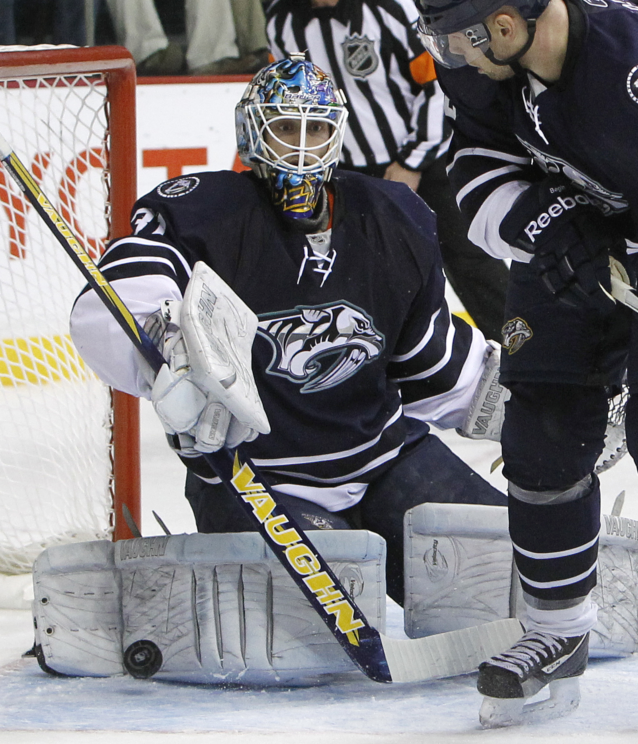 FILE - In this Dec. 18, 2010, file photo, Nashville Predators goalie Mark Dekanich (31) can't stop a shot by Los Angeles Kings left wing Ryan Smyth, not shown, in the second period of an NHL hockey game in Nashville, Tenn. Dekanich is one of 15 players de
