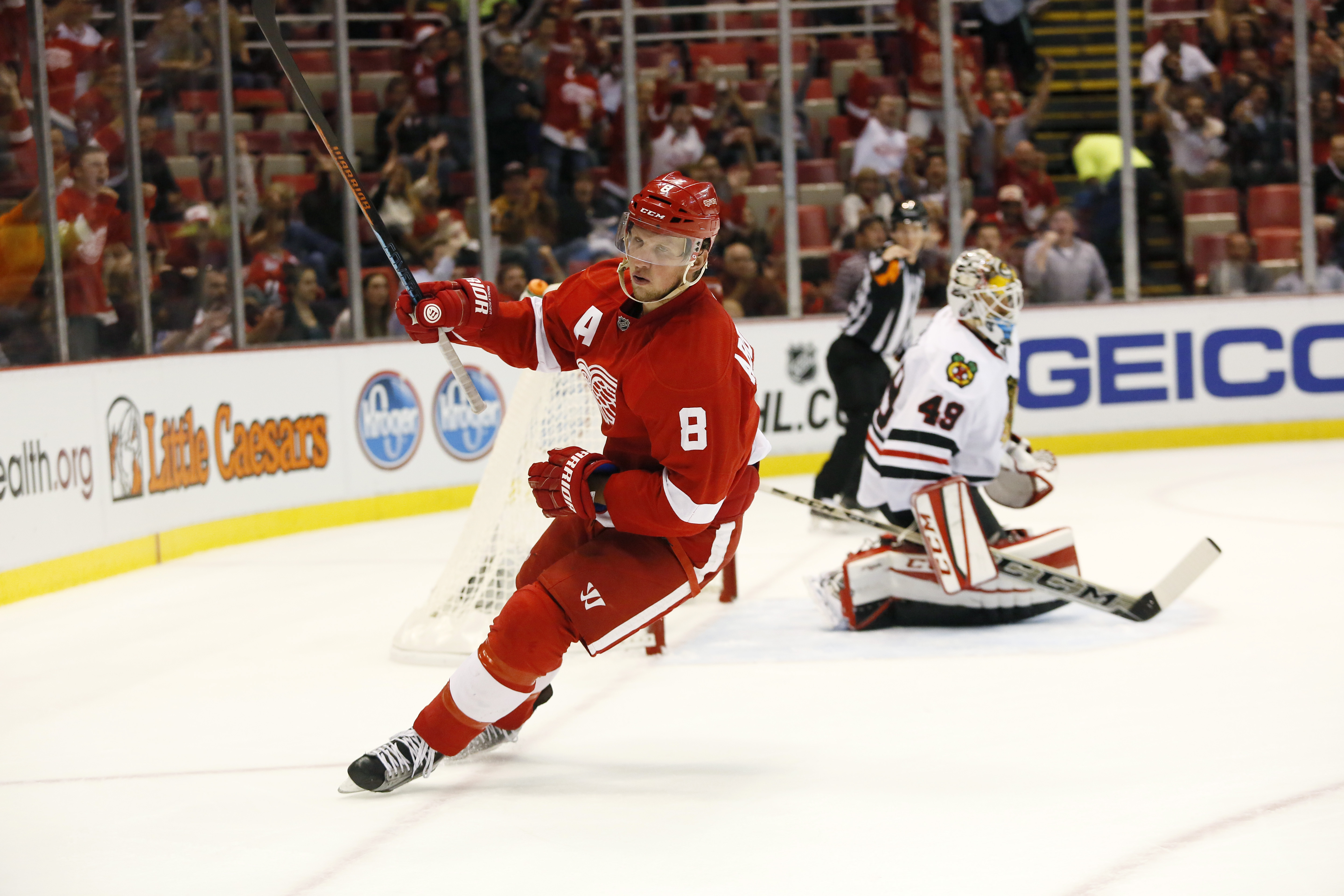 Detroit Red Wings' Justin Abdelkader (8) celebrates his goal against Chicago Blackhawks' Michael Leighton (49) during the second period of a preseason NHL hockey game at Joe Louis Arena Wednesday, Sept. 23, 2015, in Detroit. (AP Photo/Duane Burleson)