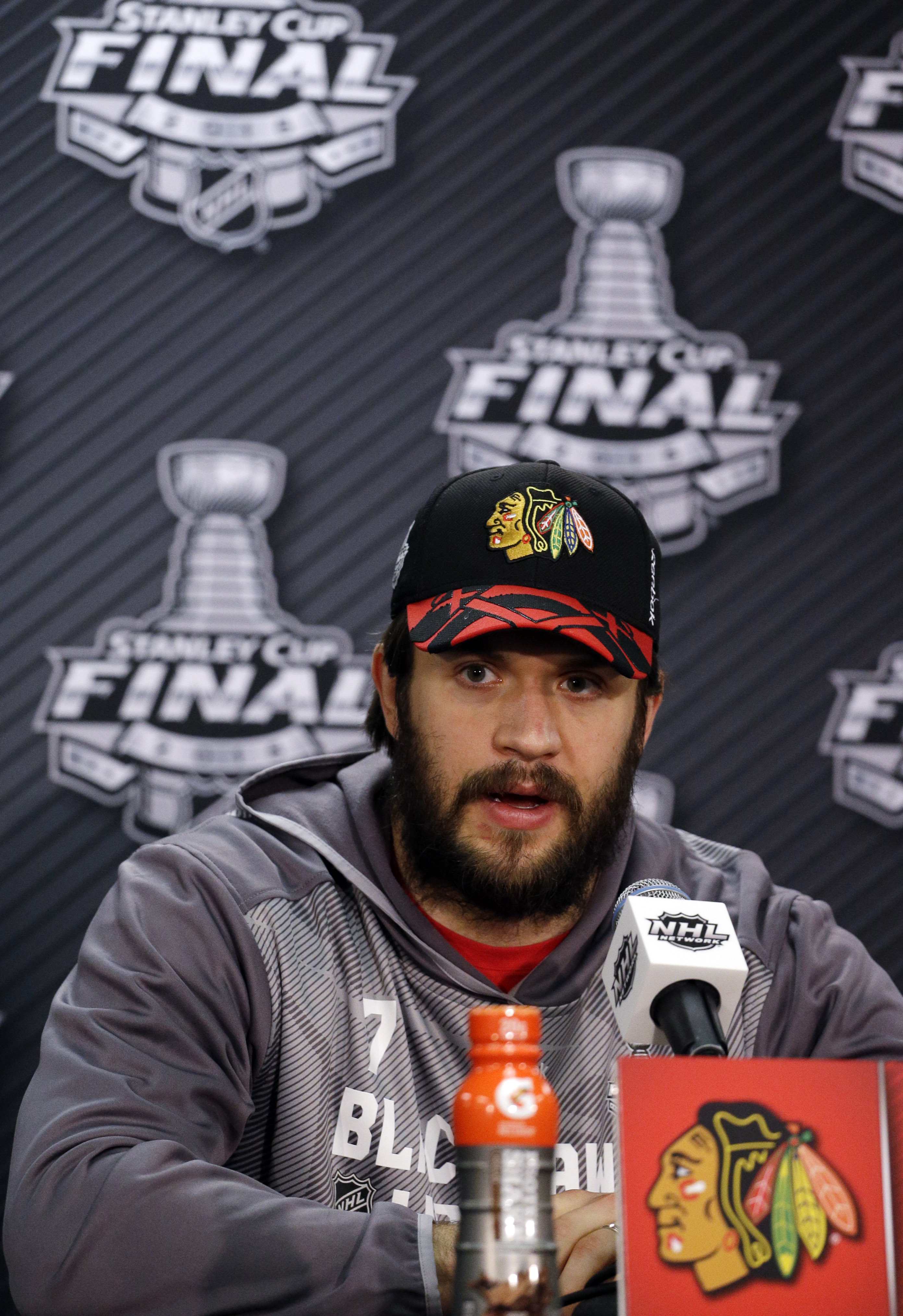 Chicago Blackhawks defenseman Brent Seabrook talks during a news conference at the NHL hockey Stanley Cup Final, Sunday, June 14, 2015, in Chicago. Chicago Blackhawks now leads the series 3-2 and has the opportunity to win the Cup at home for the first ti